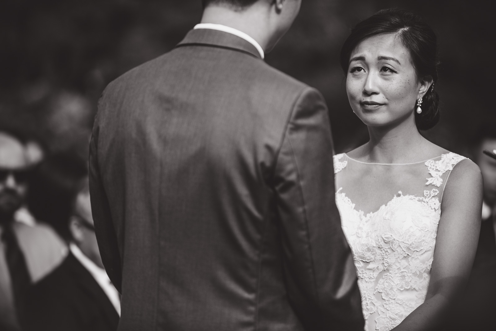 dramatic black and white portrait of bride during wedding ceremony at cecil green park house on ubc campus in vancouver - victoria wedding photographers