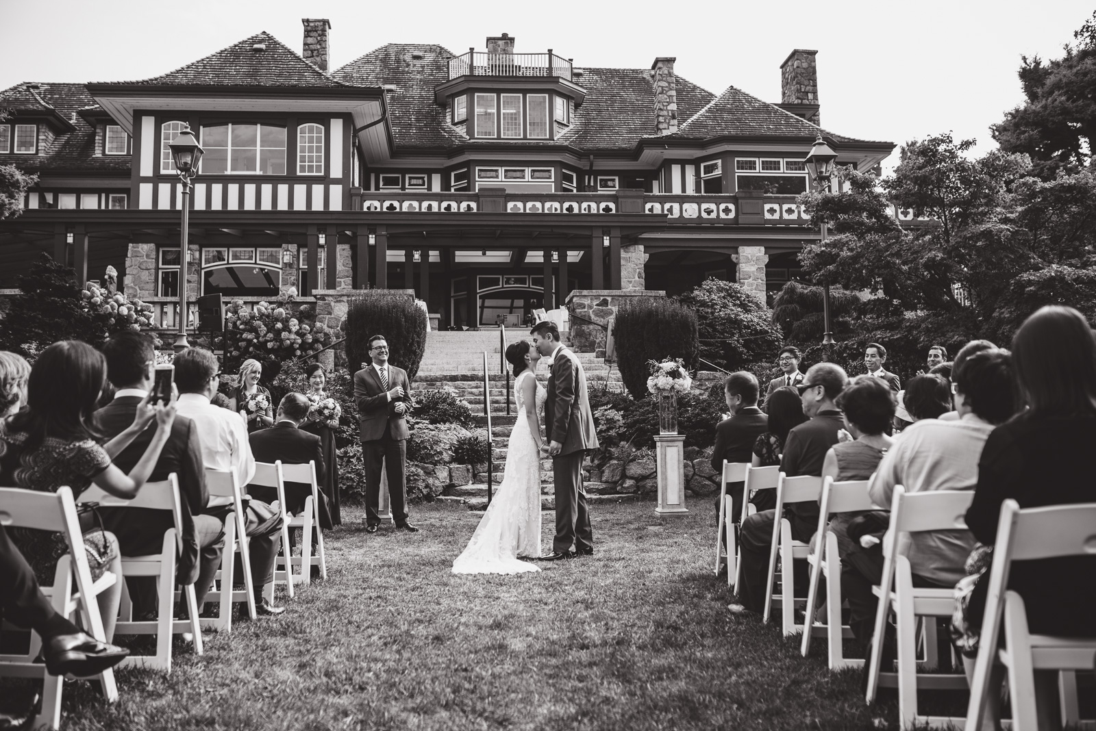 wedding first kiss at cecil green park house on ubc campus in vancouver - victoria wedding photographers