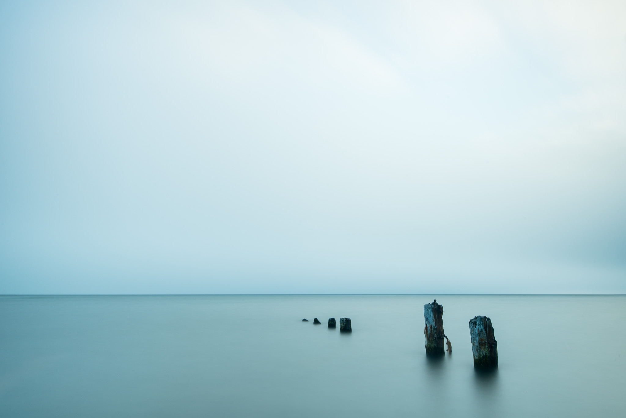 """After the fog came in we left Sheringham Point and headed to Jordan River where we photographed this row of pilings. The fog on the horizon actually made for a great backdrop, creating an """"infinity"""" effect where typically you can see the Olympic Peninsula in Washington."""
