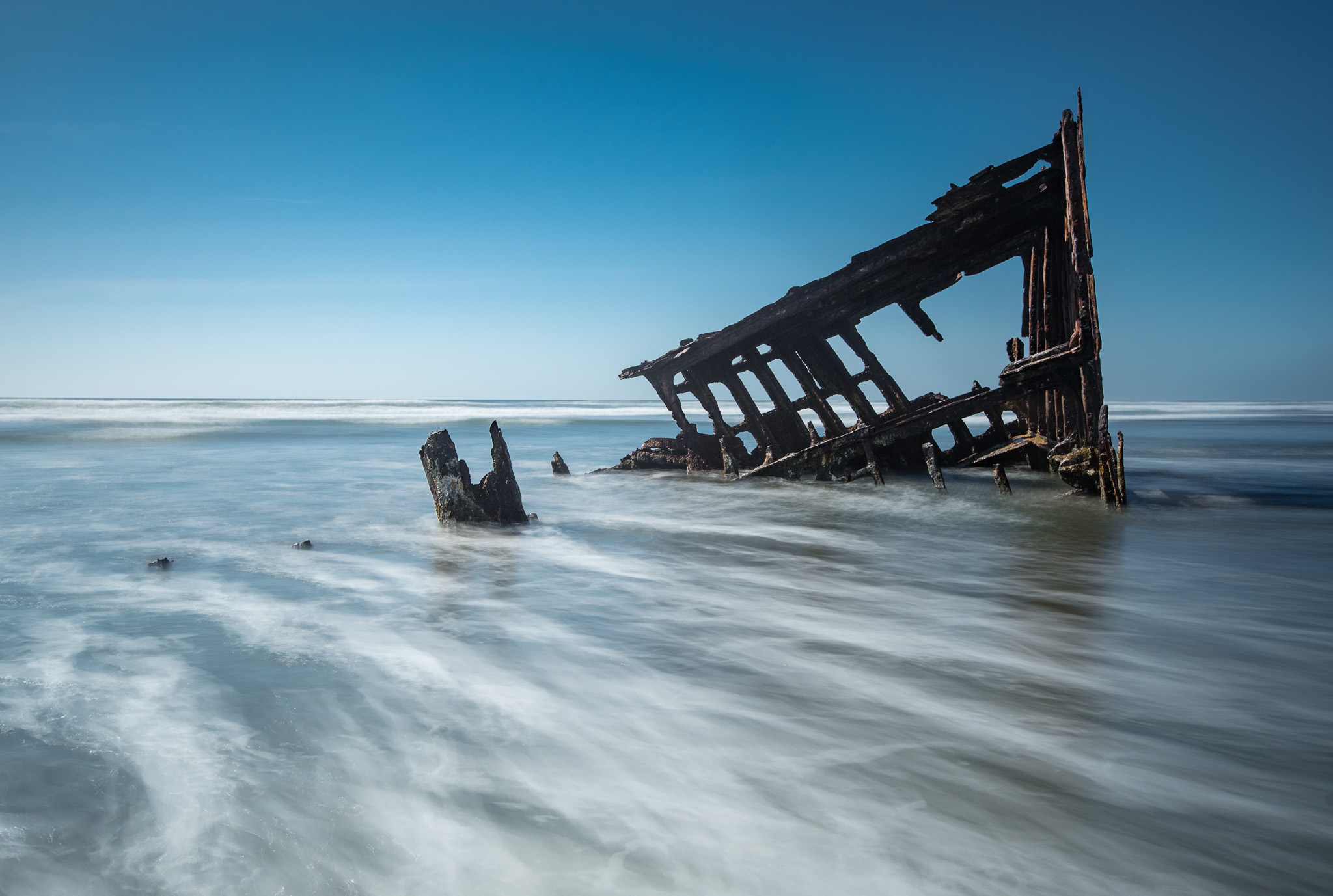 We headed further up the coast, stopping in to see this shipwreck at Fort Stevens State Park at the very Northern tip of Oregon, near Astoria. What this picture doesn't reveal is that the beach was packed with people all over the place, and we got pounded by waves to get the shots! We were regularly diving to save our gear from getting knocked down by waves.