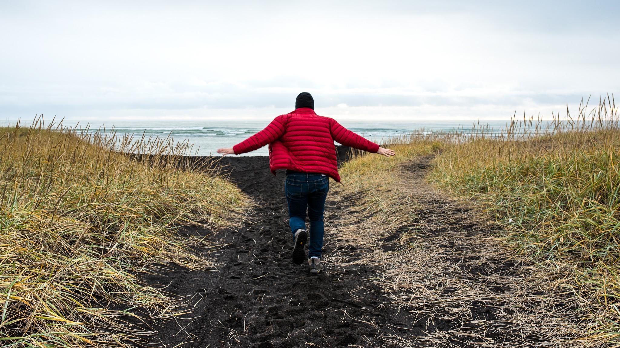 Matt makes a break for the black sand beaches.