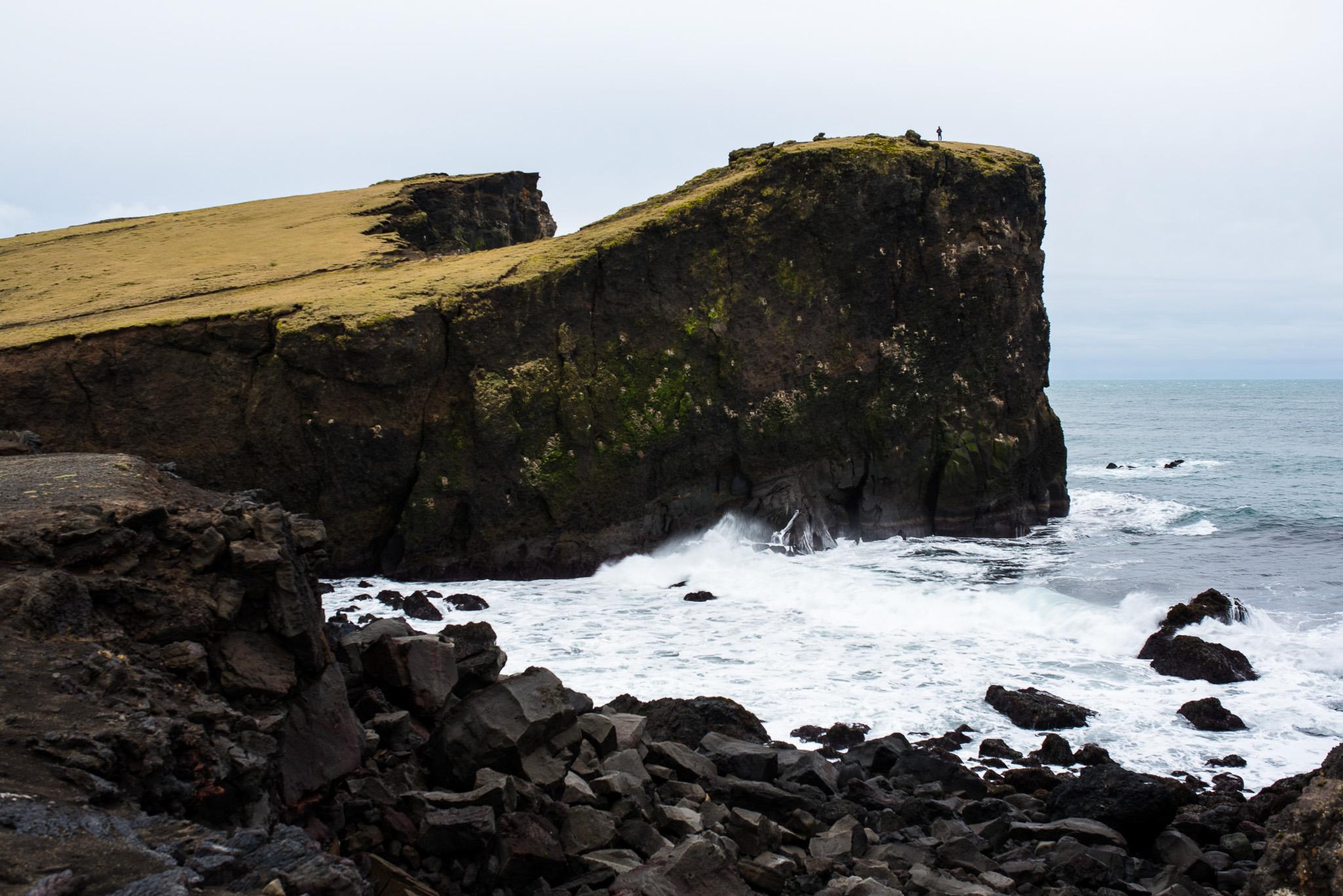 Tiny man, big cliffs.
