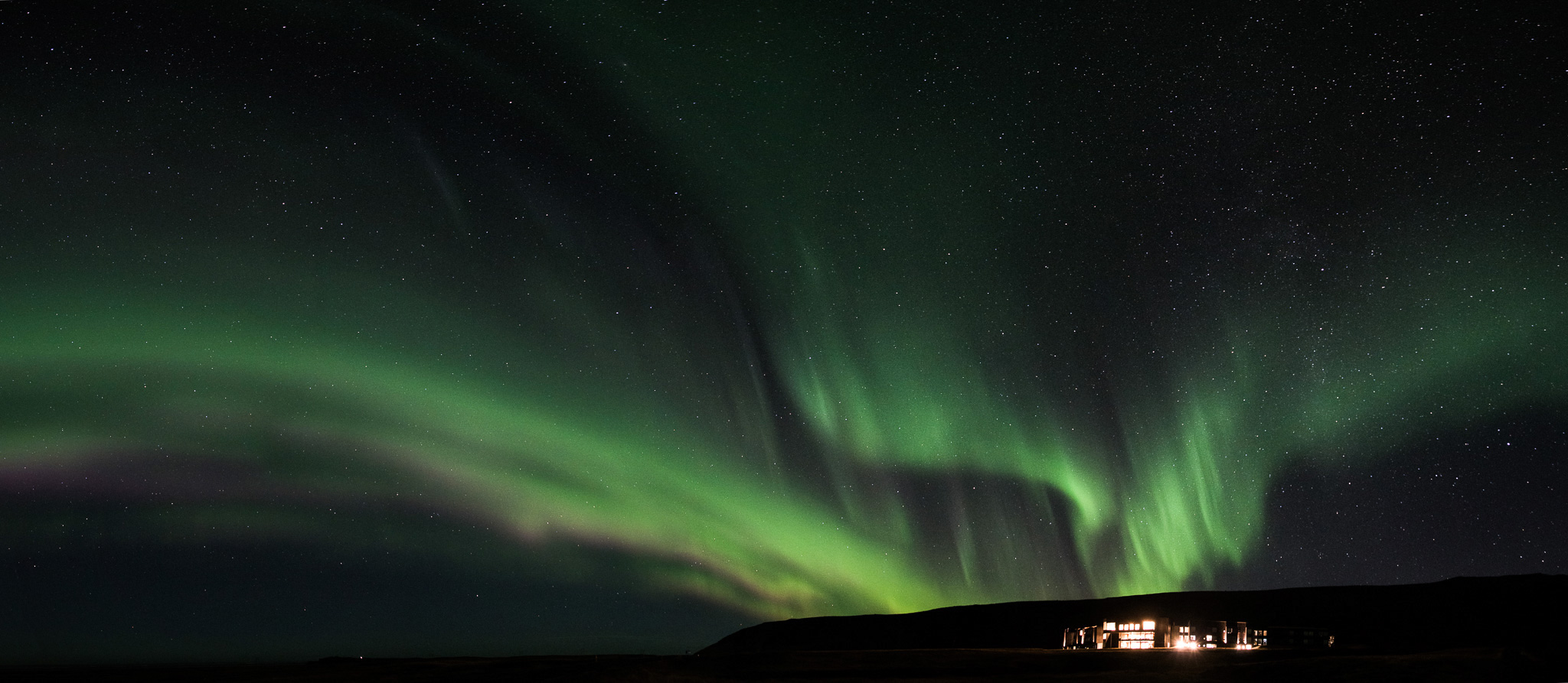 Watching the northern lights from our hotel room, and FossHotel.