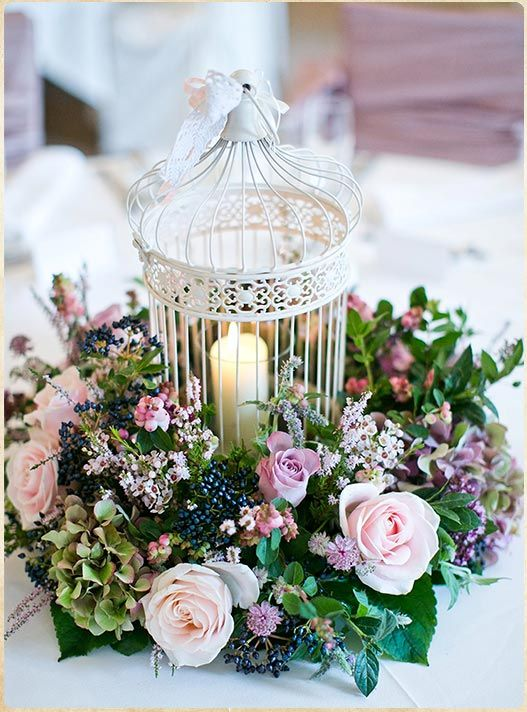 26-a-cage-used-as-a-candle-holder-and-surrounded-with-lush-lilac-blooms-and-greenery.jpg