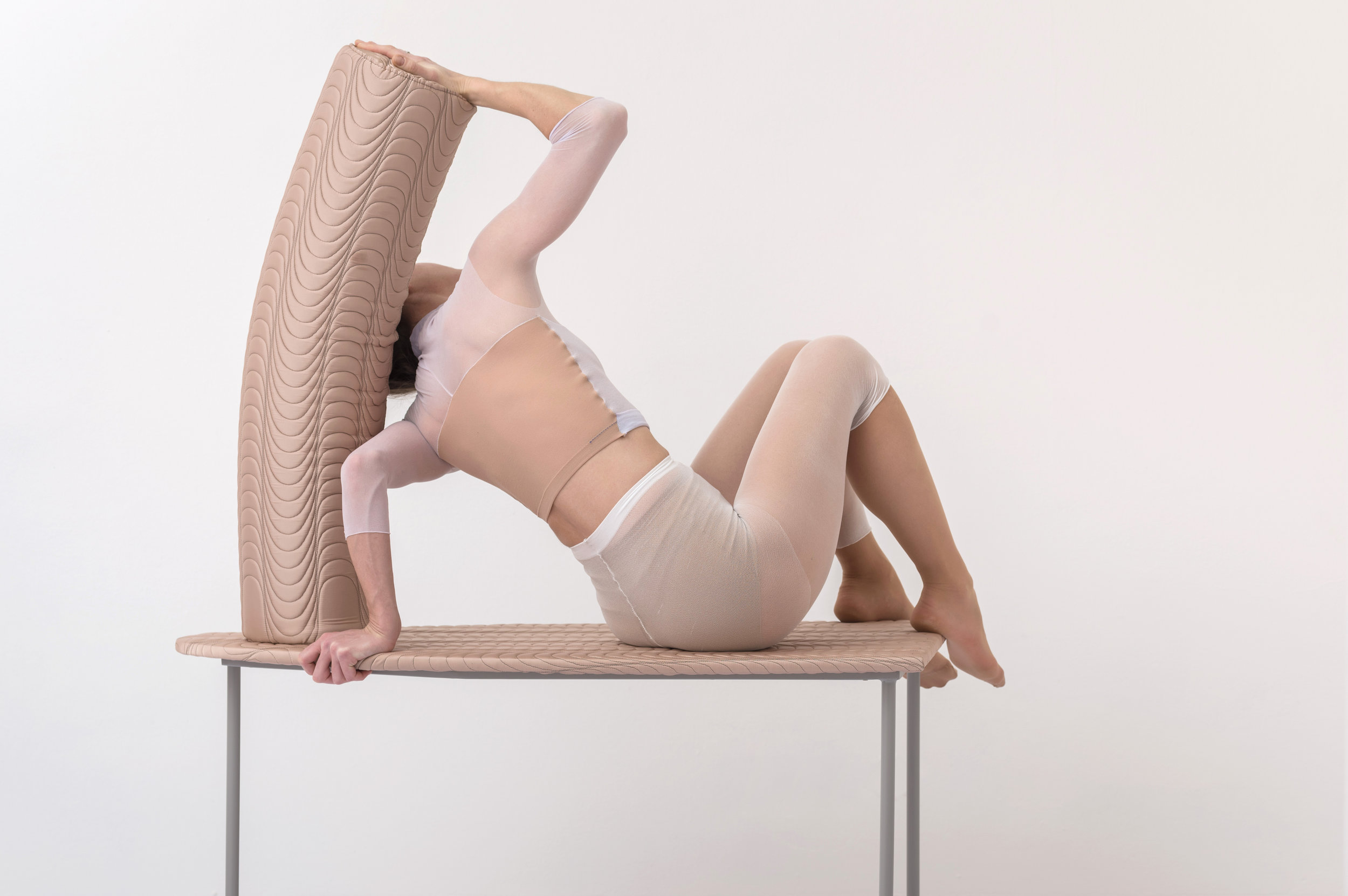 _8b_Klára Hosnedlová, Untitled (from the series Girls Want to Learn) wood upholstered furniture with model Nataša Novotná, 2018.jpg
