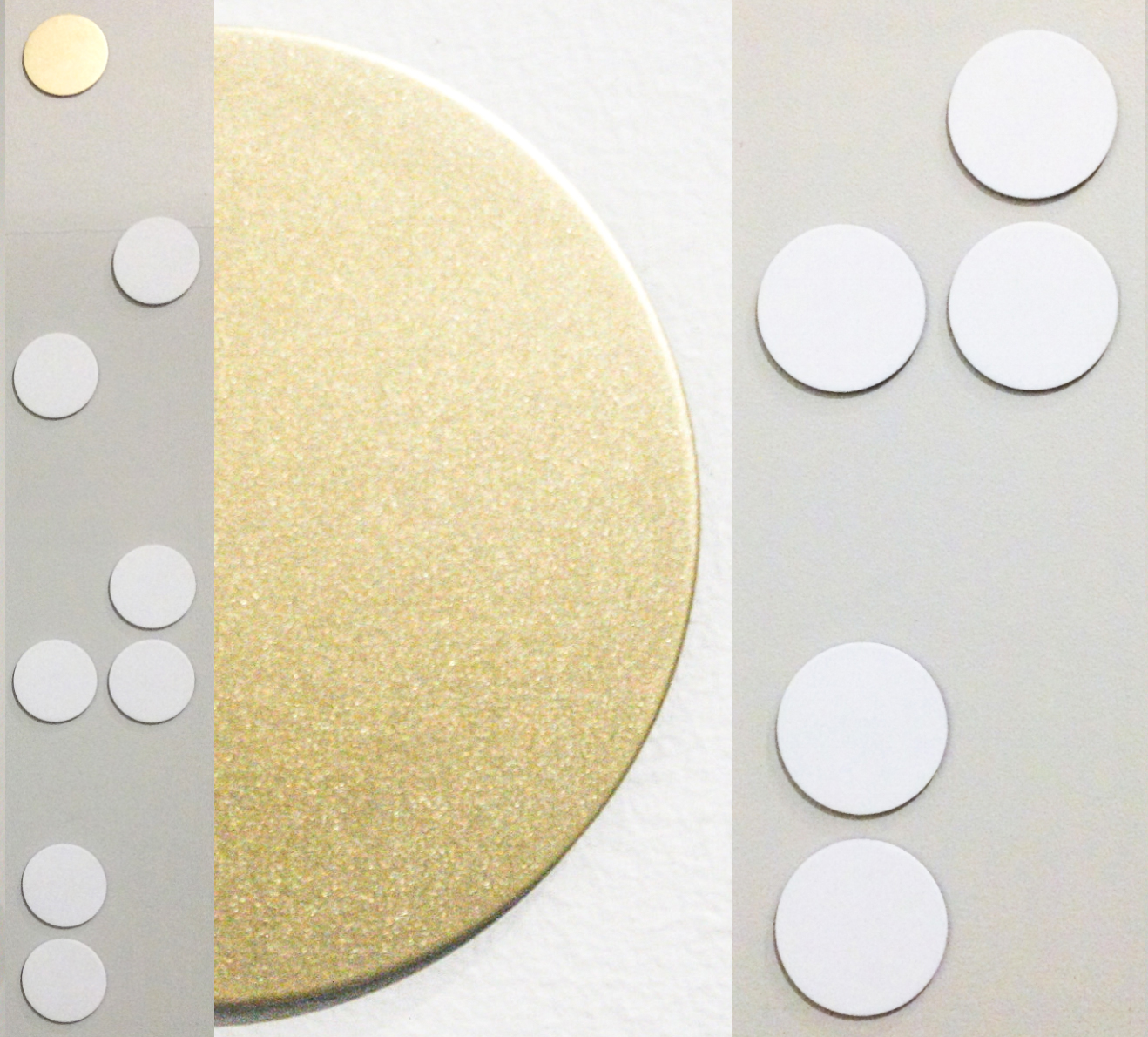 "Ida_Pingala  2017  -   28 x Flat mounted 2.5"" diameter, white/gold painted discs, arranged in series."
