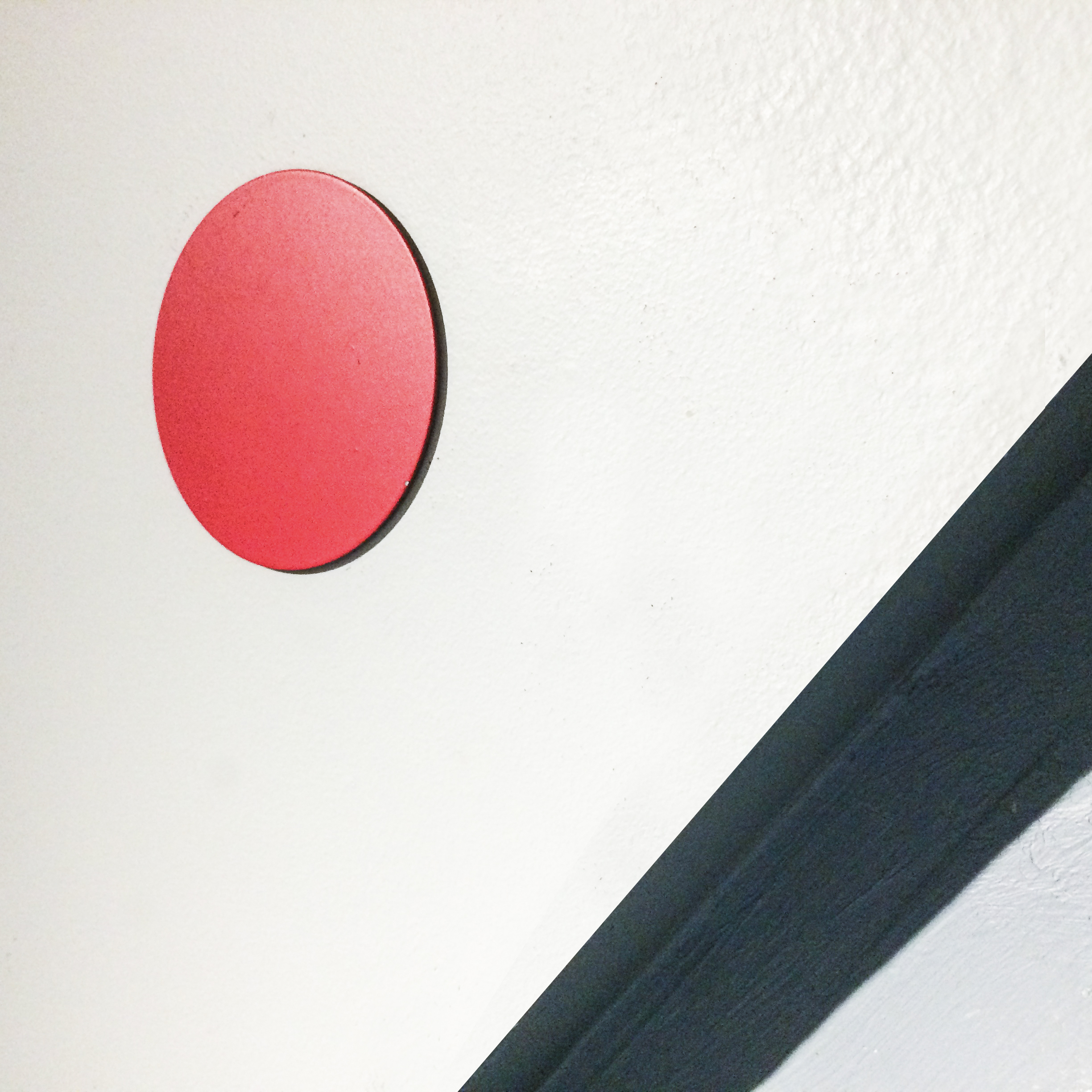 "Delivery System,  2017 -  2 x Flat mounted 3"" diameter, red painted steel disc, contextually arranged."