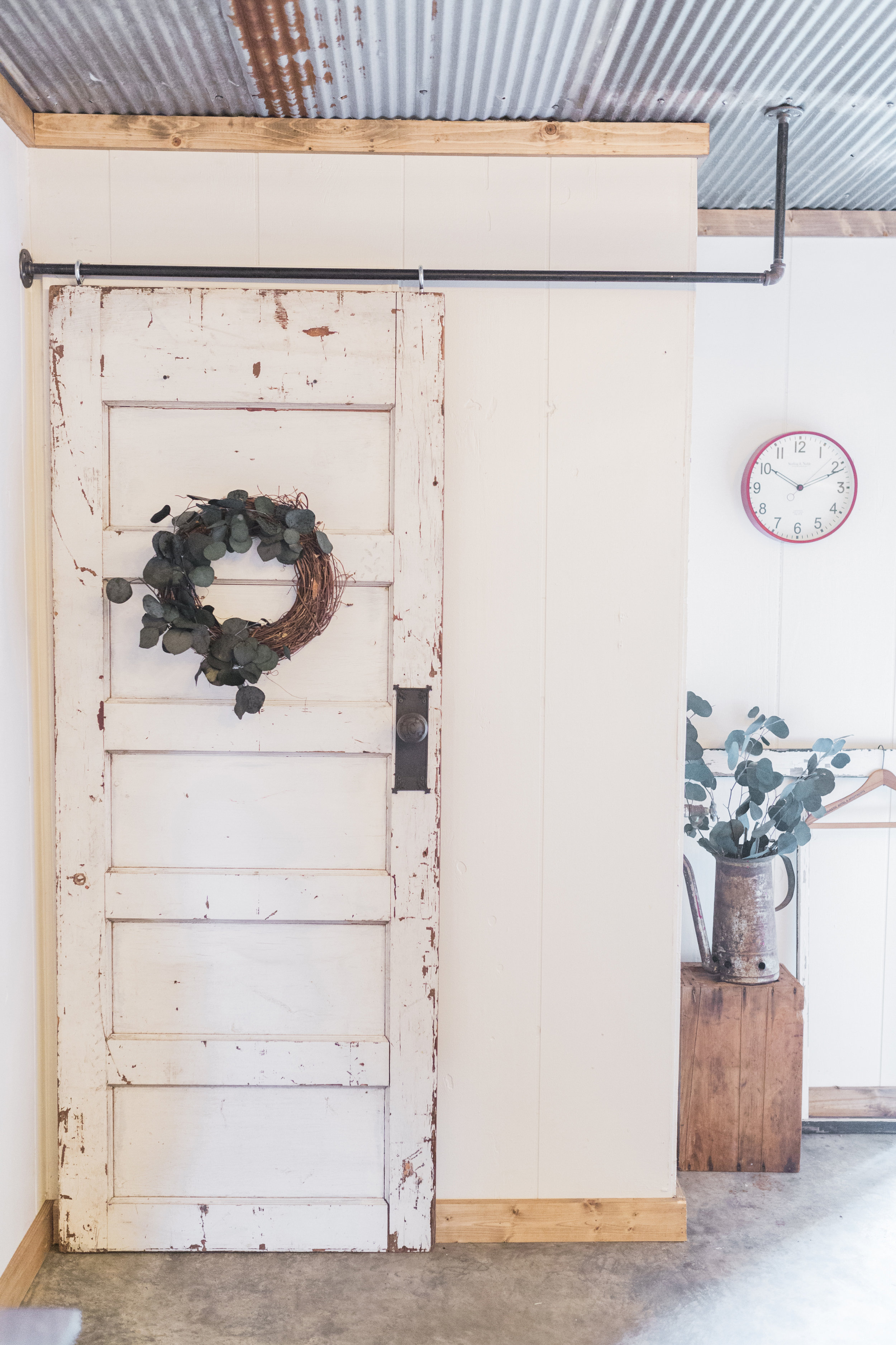 I got this great door at  Rosebud's Grand Antique Mall and we hung it on faux sliding door hardware. I found the knob at an antique store and it's actually out of an old bank in St. Louis.