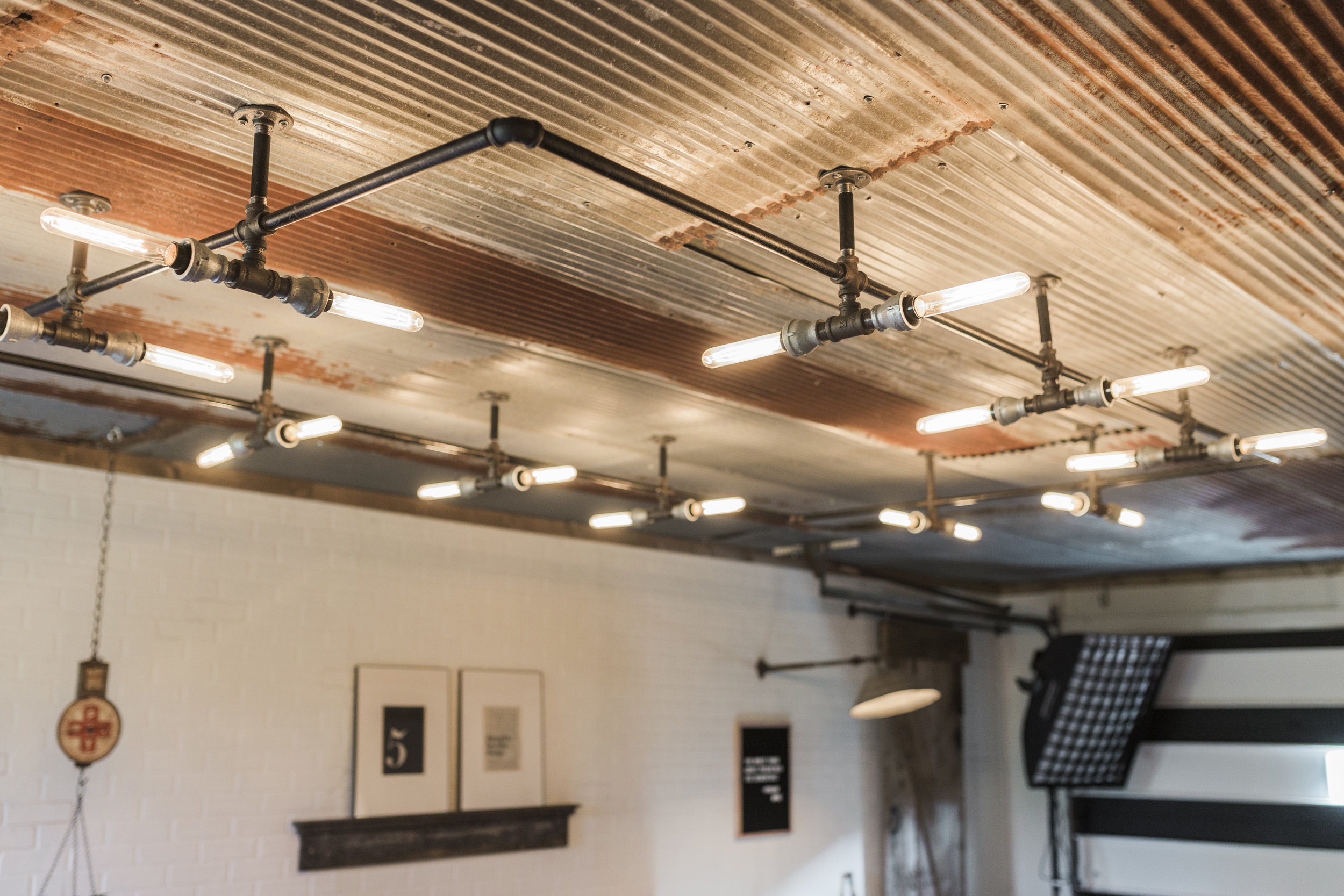 We had the hardest time finding ceiling lights. We looked everywhere especially online and couldn't find anything we loved so we drew it out and built it ourselves. I mostly assisted, Curtis did most of the hard work!