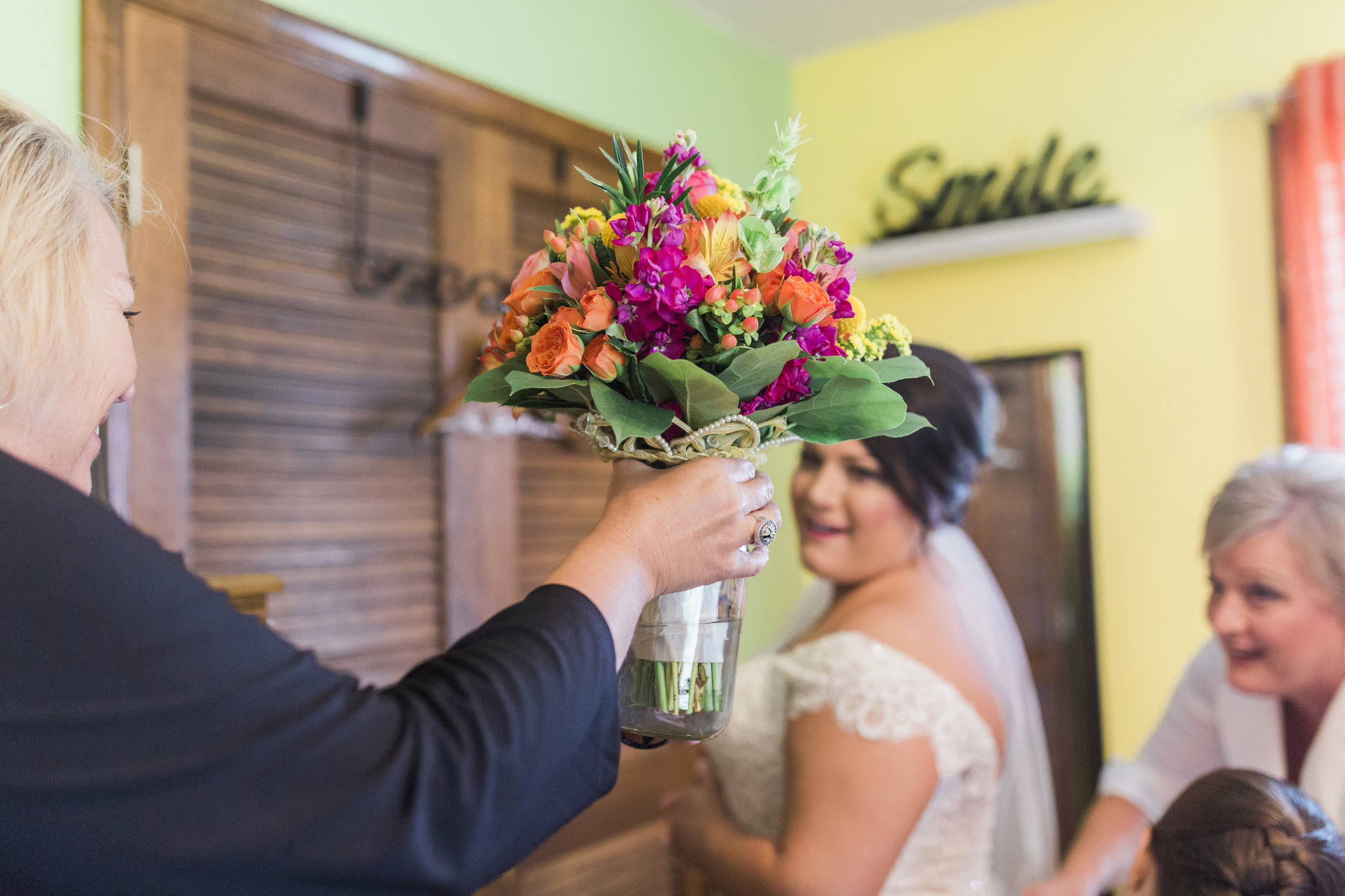 The bouquet base is a family heirloom and was a surprise to Holly.