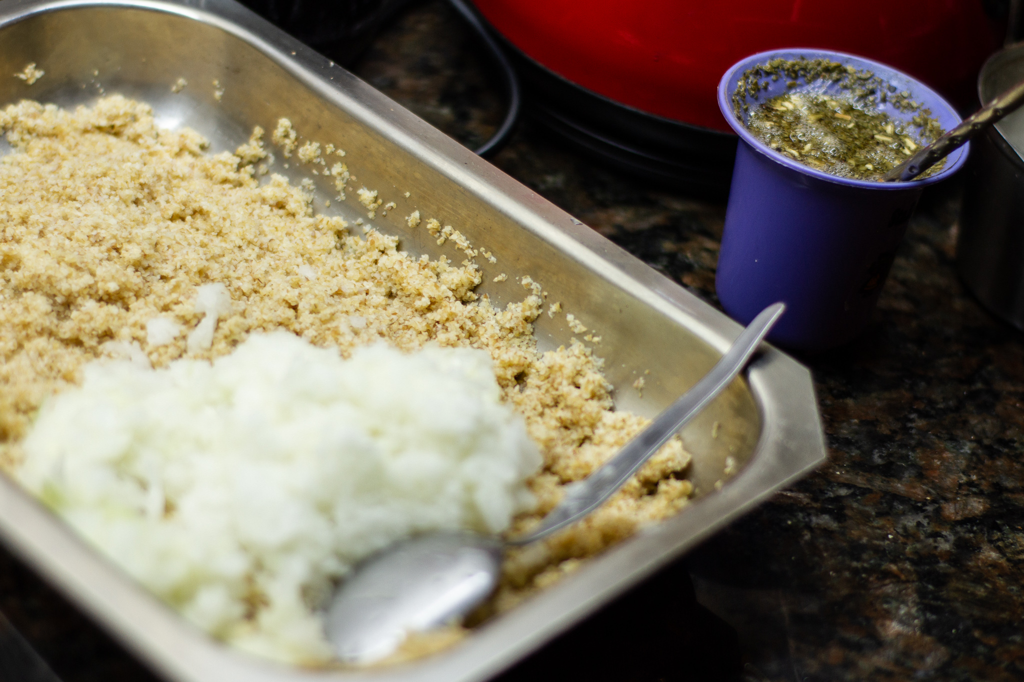 Soaked and drained bulgur with grated onion, mate alongside.