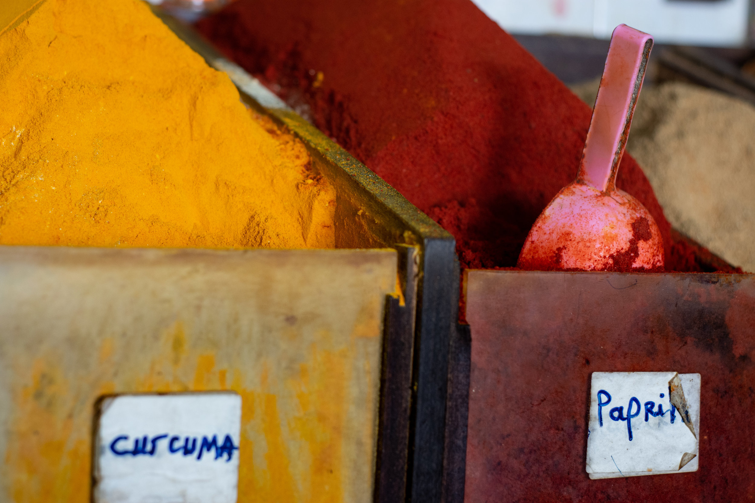 Containers of self-serve ground curcuma (turmeric) and paprika