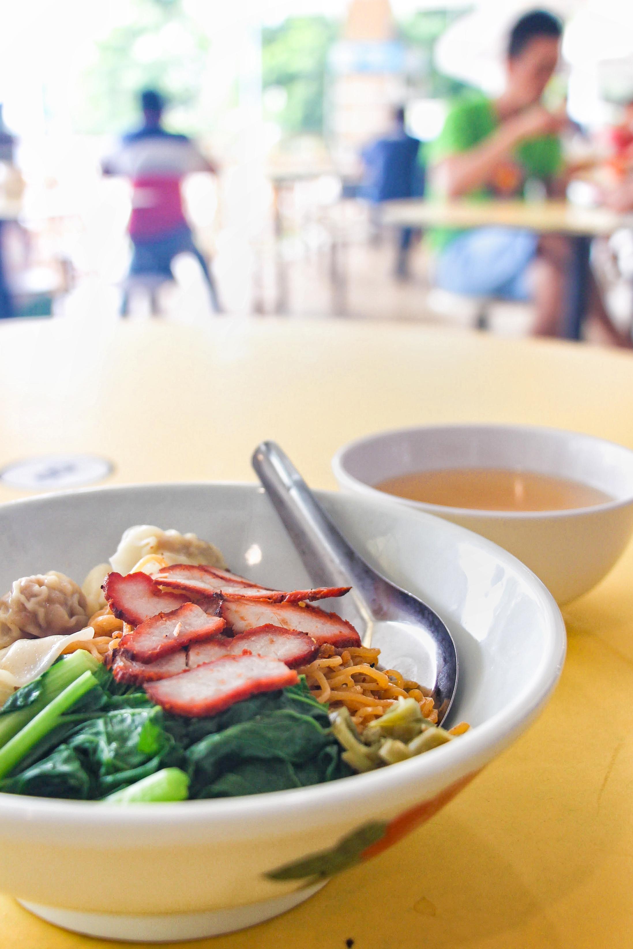A Cho Kee Noodle dish: Wonton Mee noodles with bok choy, wonton dumplings, char siu pork shavings and a broth side.