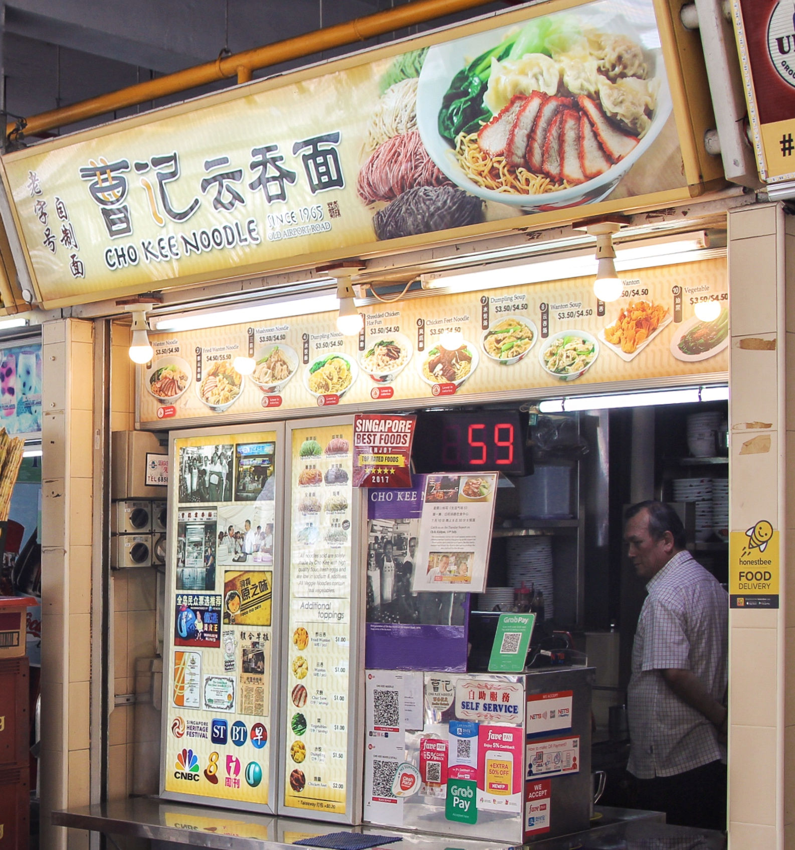 Cho Kum Kong awaits customers inside Cho Kee Noodle stall in the Old Airport Road hawker center.