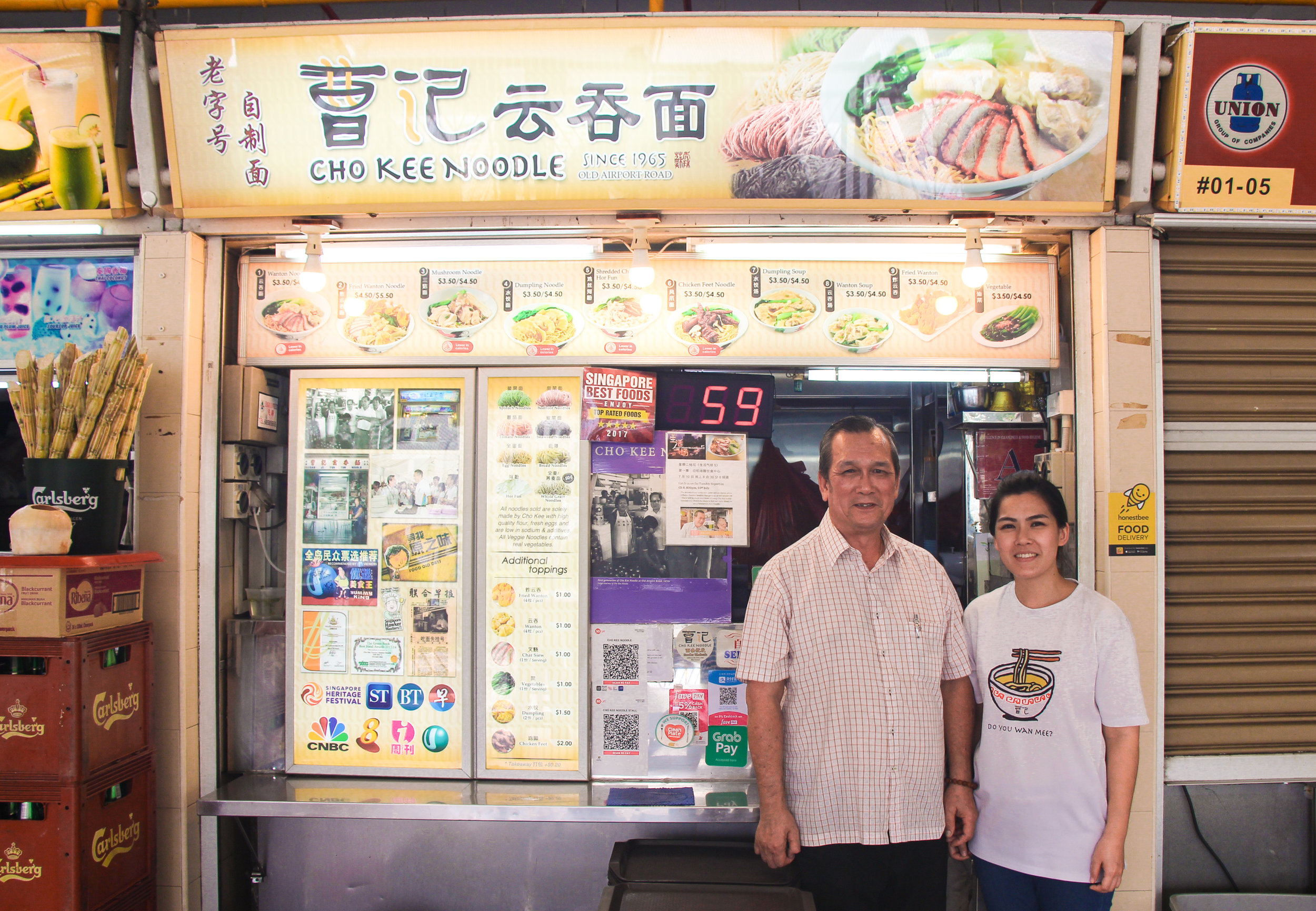 Ai Min and her father Cho Kum Kong stand proudly outside Cho Kee Noodles.