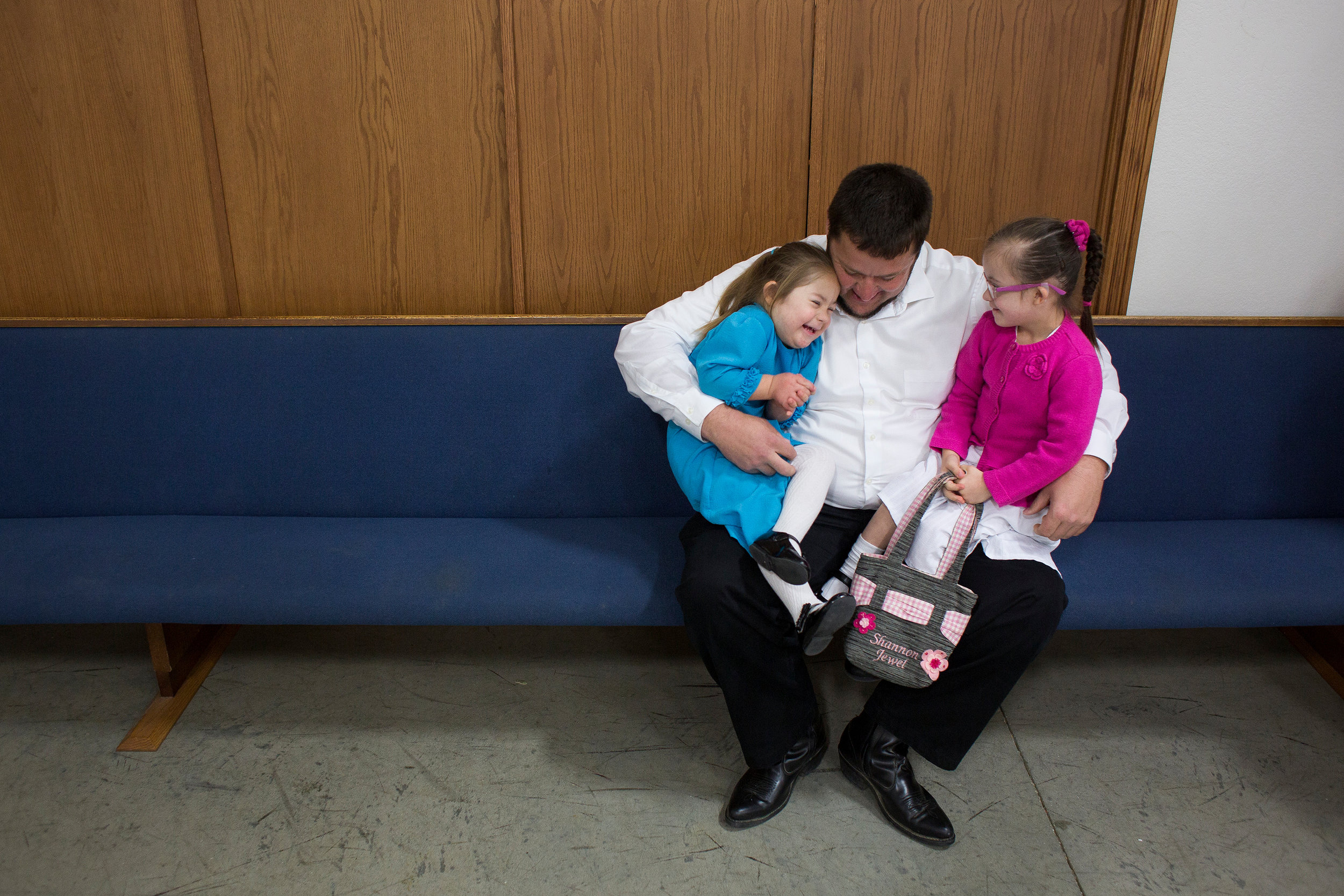 Stanley balanced Andrea and Shannon Wagler of Loogootee, 6, on his lap following a Sunday morning service Oct. 29 at Mt. Nebo Mennonite Church near Newberry, on the Scotland-Newberry Road. Stanley said Andrea and Shannon are two of three girls who attend Mt. Nebo who have Down syndrome.