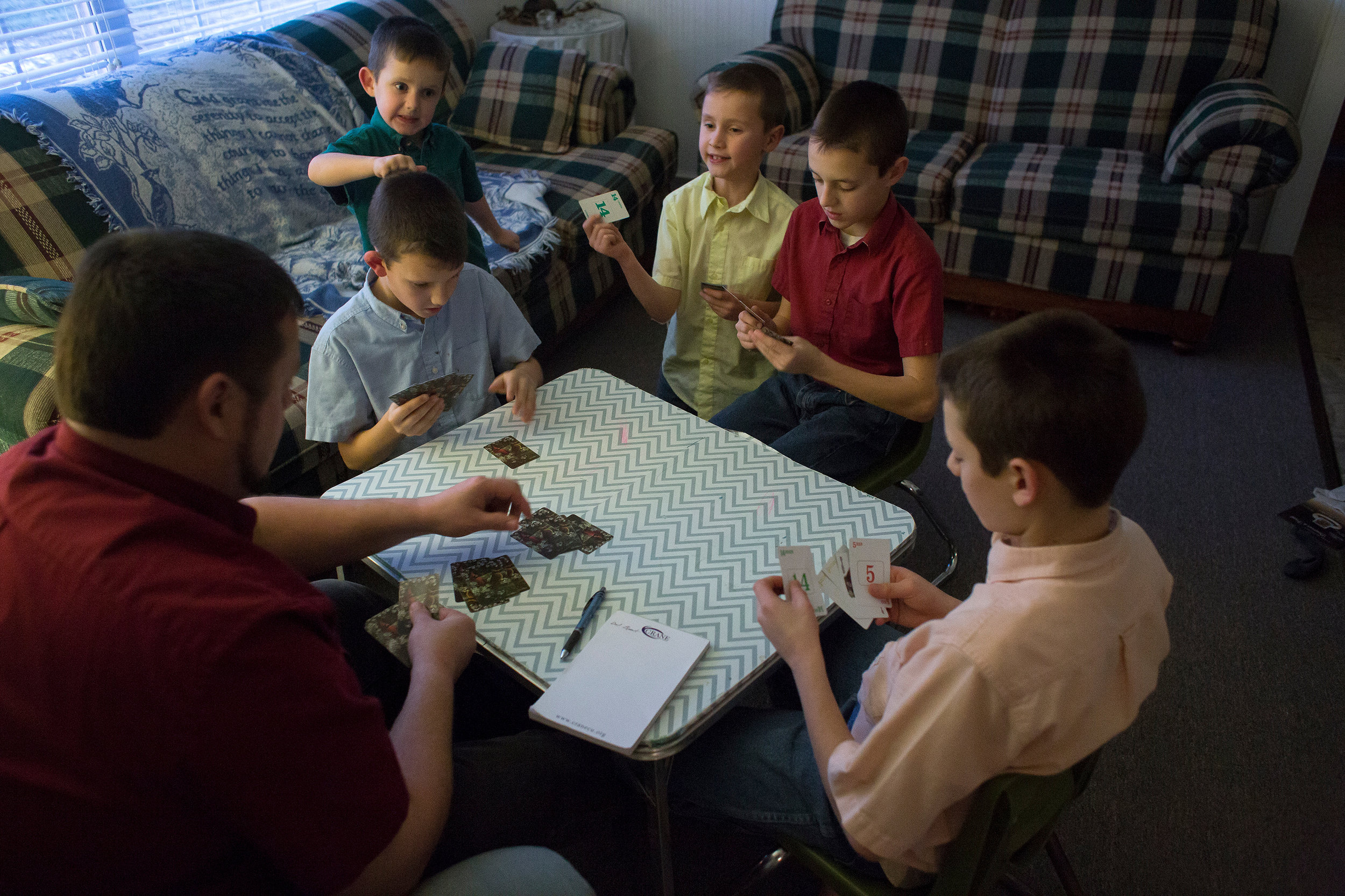 Stanley played Rook with his sons — Bryant, Cody, Darius, Tyler and Zachary — to pass time before dinner Dec. 30. Because they don't have a television, reading books and playing games like Rook are common occurrences in the Knepp household. During the warmer months of the year, the children spend more time with outdoor activities.