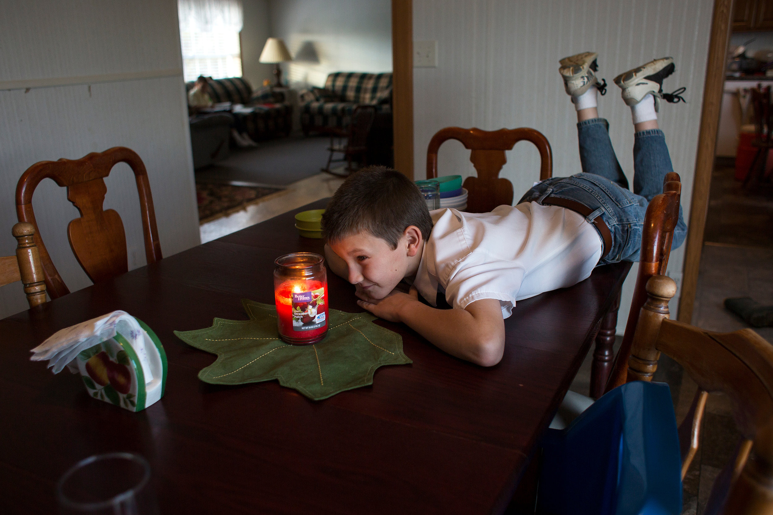Darius watched a candle burn before setting the dinner table Oct. 31.