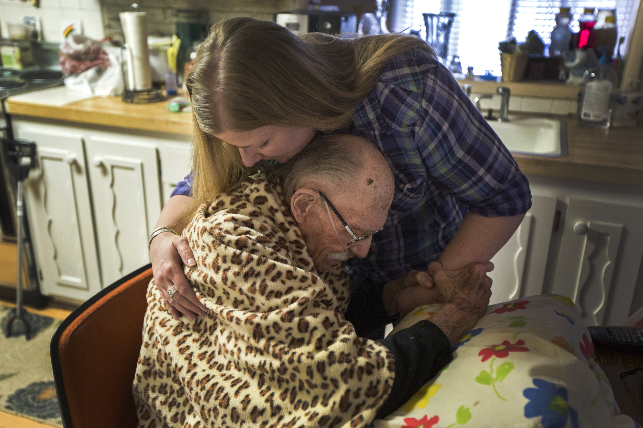"""""""It's rough,"""" Jasmine Parker said about taking care of her father. """"I don't know if it's going to be weeks or months. I mean I feel like he doesn't have that much longer to go."""" The Lehi resident said this Jan. 27 about her 79-year-old father, Richard """"Dick"""" Fisher, of Cottonwood Heights, who died March 20. Fisher quit smoking more than 20 years ago, but died of chronic obstructive pulmonary disease (COPD) which Mayo Clinic defines as """"a chronic inflammatory lung disease that causes obstructed airflow from the lungs."""" Fisher would receive help throughout the week from various professionals and Parker would visit her father every weekend and sometimes throughout the week depending on her schedule. """"It's hard to run two households,"""" she said speaking also about her own family. """"But what do you do? I mean they take care of you when you're little so I mean it's the right thing to do."""" Pictured: Fisher is embraced by his daughter, Parker, before she departs from her father's home Jan. 27 in Cottonwood Heights. — Jan. 27, 2018, Cottonwood Heights, Utah."""