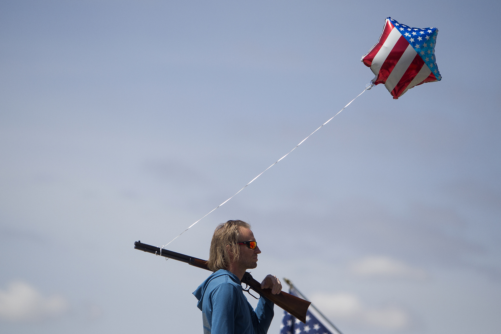 """Jason Desmond, of Lehi, rests his Winchester rifle, given to him by his grandfather, on his shoulder while attending a pro-gun rally on the steps of the Utah State Capitol on April 14 in Salt Lake City. Desmond said he attended the event because he believes people need to come out to support what they believe in. """"This is something I believe in,"""" Desmond said. """"I'm not a huge gun nut, but I don't like that the Second Amendment is under attack and getting all the attention that it is in the media."""" At the protest, demonstrators heard from numerous speakers airing their anti-gun control beliefs. — April 14, 2018, Salt Lake City, Utah."""