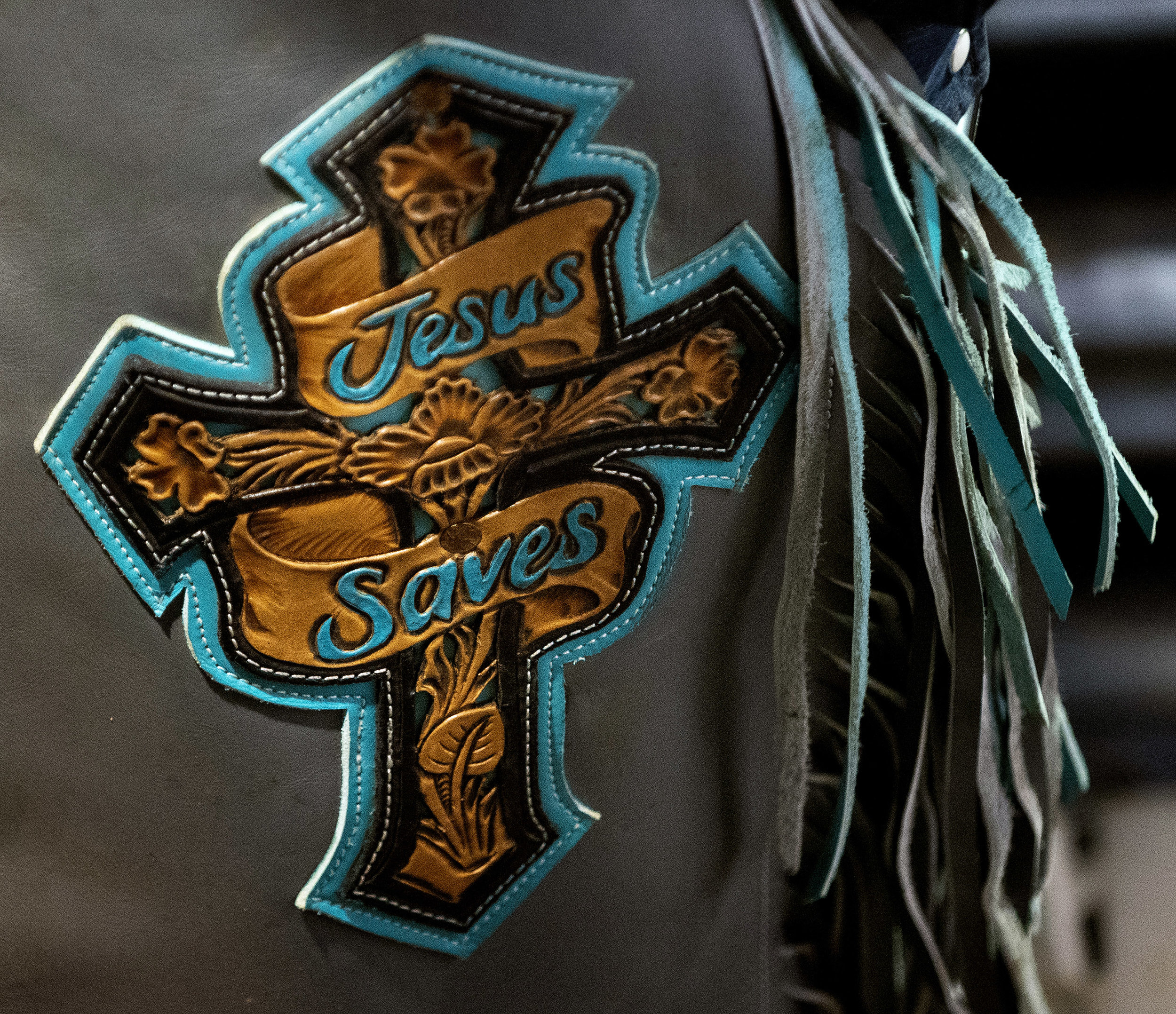 "The chaps worn by bull rider John Mincey, of West Plains, Mo., at the rodeo. ""I feel like God give me a talent to use to glorify him and be a light in this world,"" Mincey said about why he competes in rodeos. ""Whenever I meet him, you know, I want to be like, 'God I laid it all out on the line for you. I used every bit of talent that you give me. I did the best I can.'"""