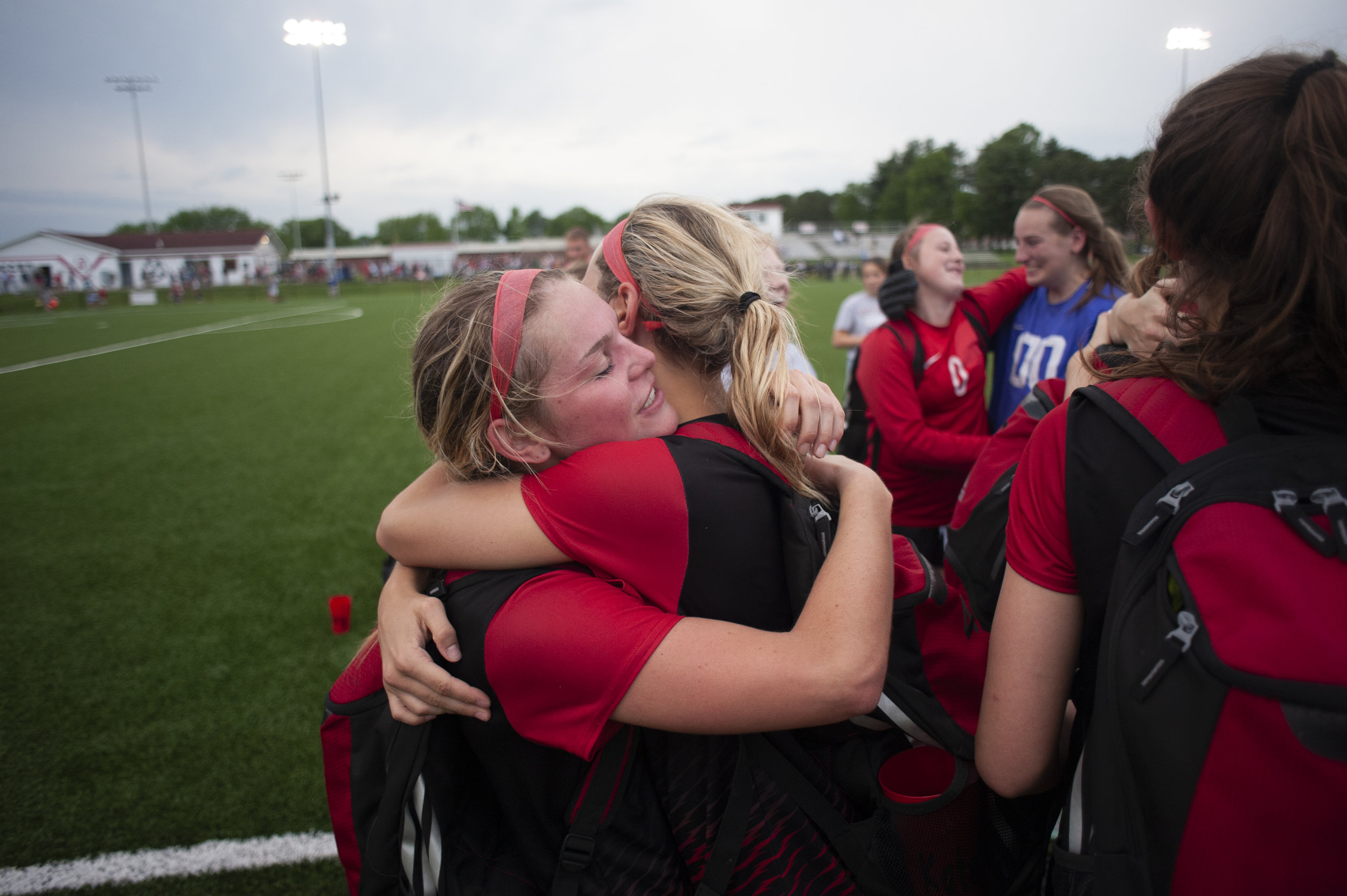 Jackson's Katelyn Miller (4), right, hugs her sister and teammate Natalie Miller (14) following the Jackson Indians' 2-1 overtime loss to Lindbergh High School in the Class 4 sectionals Tuesday, May 21, 2019, in Jackson. Jacob Wiegand | Southeast Missourian