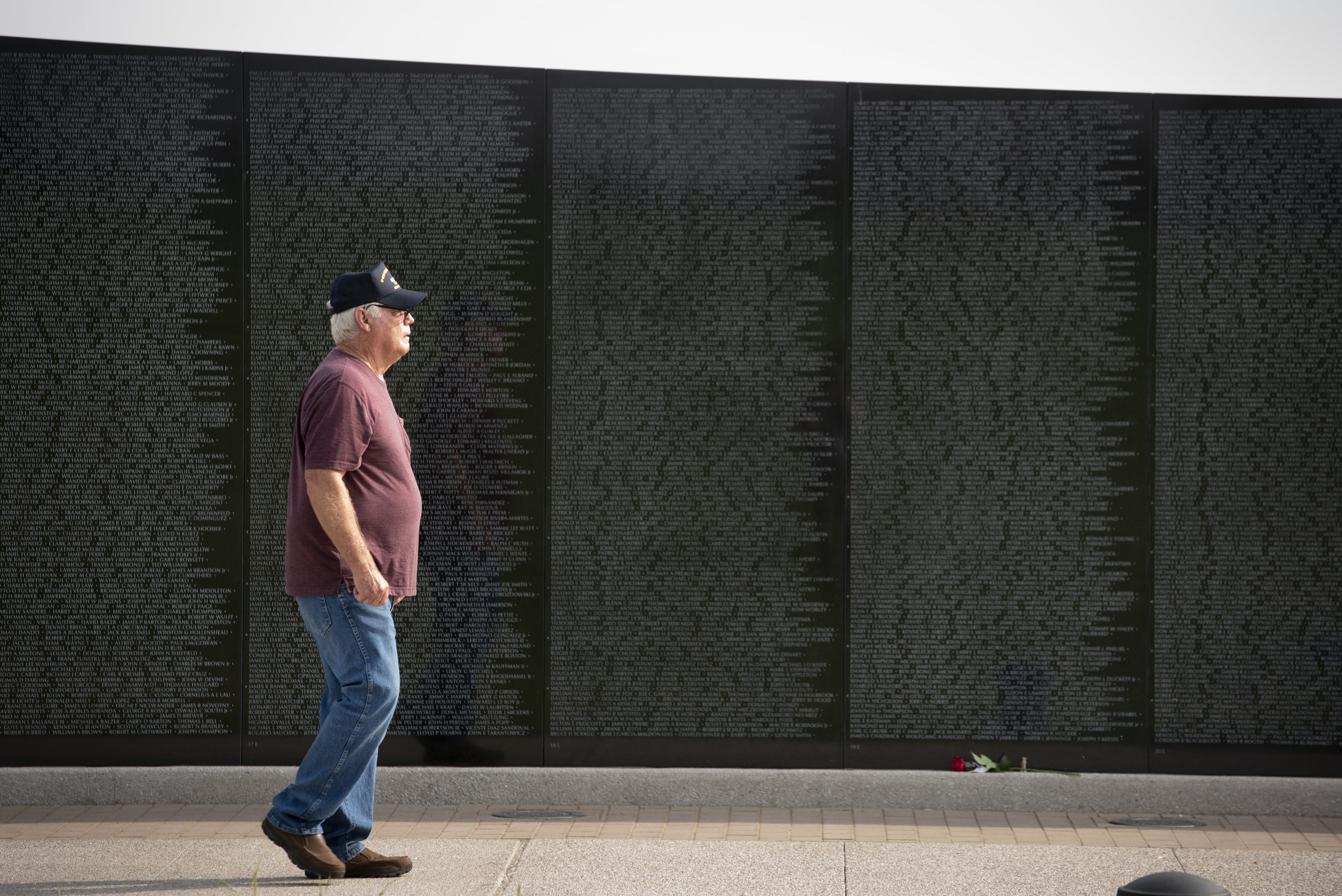 "Vietnam War veteran Jim Boyd of Pinckneyville, Illinois, walks past the names of fallen veterans, as seen on a full-scale replica of the Vietnam War Memorial in Washington, D.C., on Memorial Day on Monday, May 27, 2019, at Missouri's National Veterans Memorial in Perryville, Missouri. The name of Boyd's brother, Roger Boyd, who was killed in May of 1968 while serving in the Marines Corps, is on the wall. ""I get to thinkin' about us growing up,"" he said. ""Both my brothers were gone in the service so I didn't see them that often. And the last time we got together, I was in high school and I just think about us going camping and stuff like that. Good memories."" Jacob Wiegand 