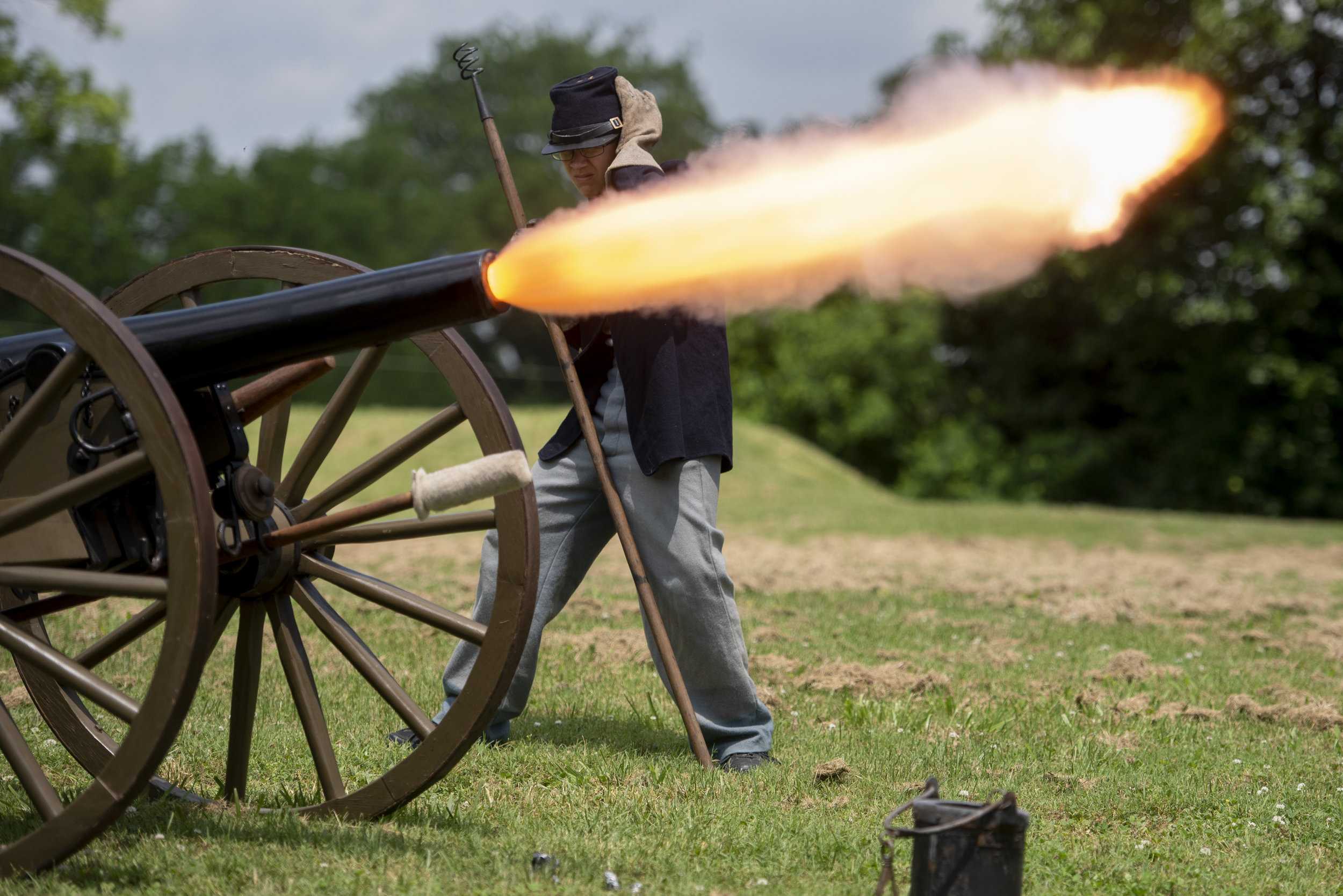 "Dressed as a Civil War soldier, Andrew Porter of Marble Hill, Missouri, 13, places a hand over the side of his head as a cannon fires during a Memorial Day at Fort D Historic Site event Monday, May 27, 2019, in Cape Girardeau. Scott House of Cape Girardeau said he and other local reenactors at the Fort D event enjoy ""keeping this place alive and bringing history to life here."" Jacob Wiegand 