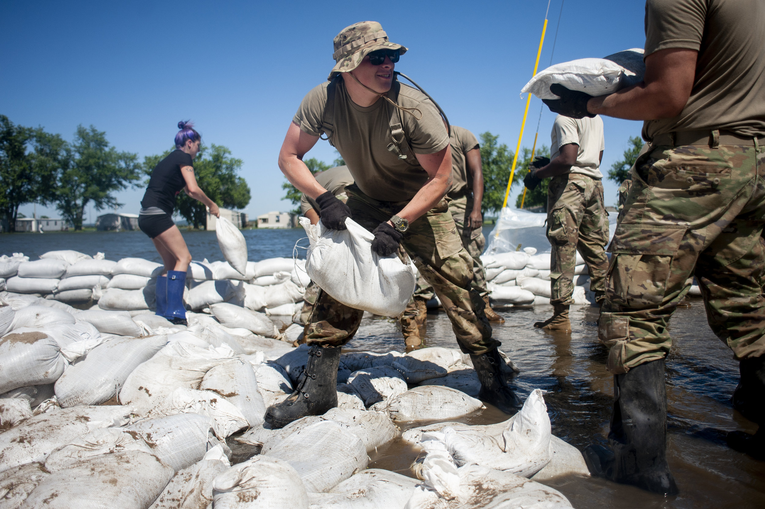Illinois National Guard member Michael Sheppard helps other Guard members build up existing sandbag barriers to hold back floodwaters Monday, June 10, 2019, along Brookwood Drive in East Cape Girardeau, Illinois. Jacob Wiegand | Southeast Missourian
