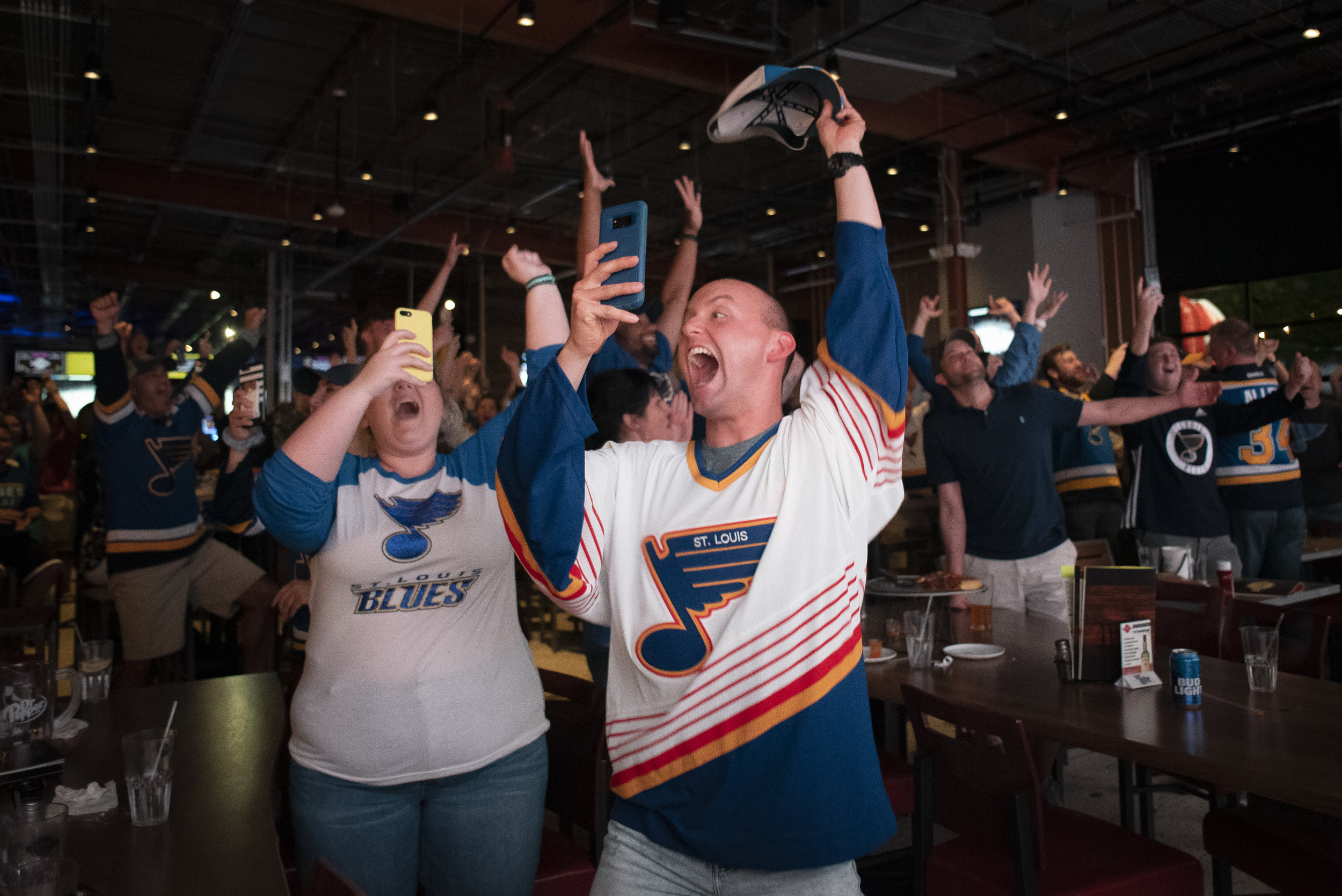 Chase Groshong of Troy, Missouri, and Madison Mingione of Perryville, Missouri, left, react to the St. Louis Blues claiming the Stanley Cup after defeating the Boston Bruins 4-1 in Game 7 on Wednesday, June 12, 2019, while watching the event at Dogwood Social House in Cape Girardeau. This was the first time the St. Louis Blues claimed the Stanley Cup in franchise history. Jacob Wiegand | Southeast Missourian