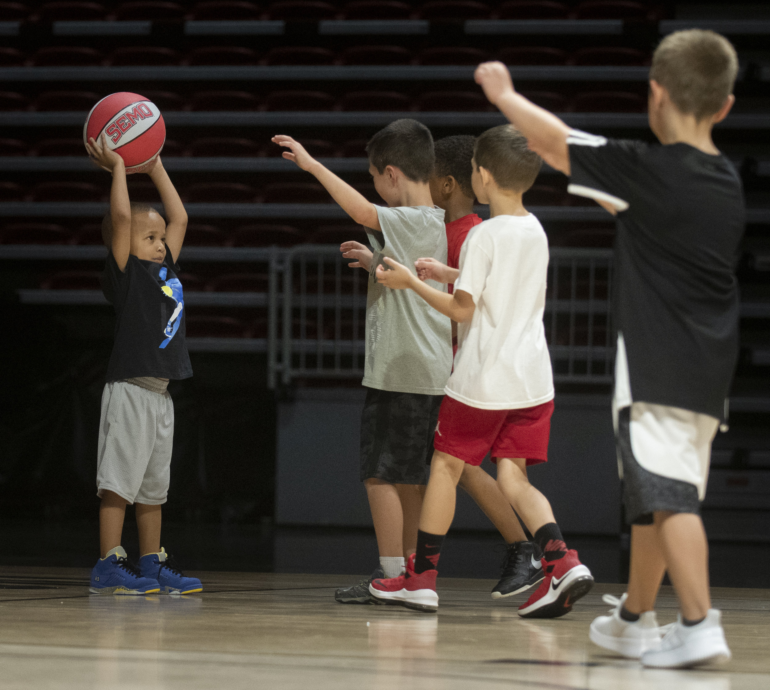 Kaden Pickens, 3, of Cape Girardeau, holds up the ball while practicing with other athletes during a summer camp with the Southeast Missouri State University men's basketball team Monday, June 17, 2019, at the Show Me Center in Cape Girardeau. Jacob Wiegand | Southeast Missourian