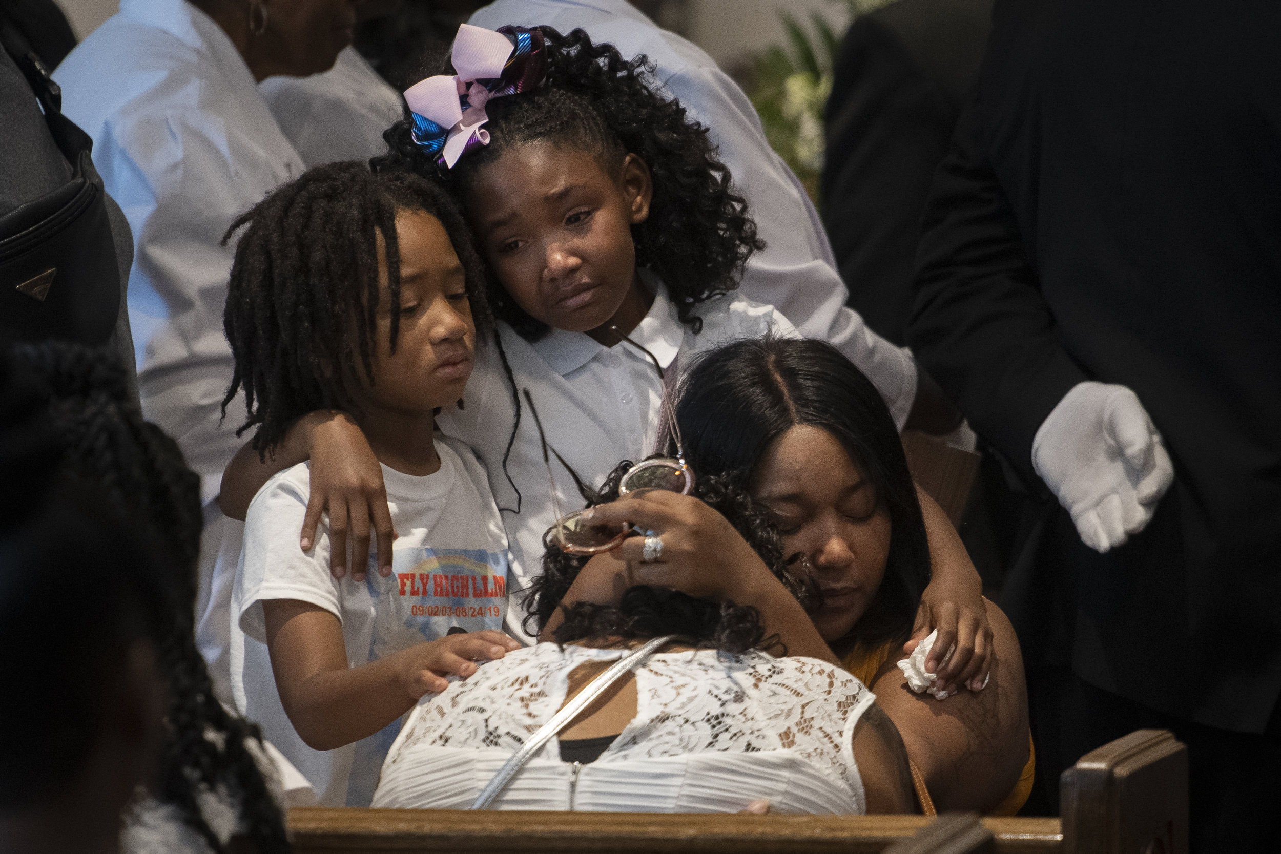 """Monday was 16 years since the birth of Madison Robinson; Tuesday was her funeral. Robinson died after being shot Aug. 24 on the front porch of her Cape Girardeau home. Scores turned out for Robinson's visitation and funeral Sept. 3 at Mercy Seat Missionary Baptist Church in Charleston. """"I'll have people remember this day, today, that a 15-year-old girl is dead in our community,"""" Robinson's cousin Alex Gilbert said. """"If you want to remember her, remember her as somebody that shouldn't have died because of the gun violence."""" Pictured from left: Sunnyboy Mims, 7, and Randi Jones, 9, cousins of Robinson; and Misty Robinson, aunt of Madison, mourn with Madison's mother Martez Johnson, with head bowed, during Madison's services. — Sept. 3, 2019, Charleston, Missouri."""