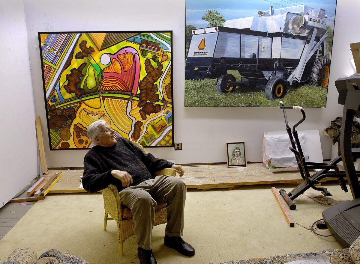 Harold Gregor takes in two works that represent bookends in his career. The aerial view of an idealized golf course was finished in November of 2015 while the massive weight of an Allis Chalmers combine was painted early in his career, around 1973. The works hang in his painting studio in downtown Bloomington. Gregor has died at the age of 89.