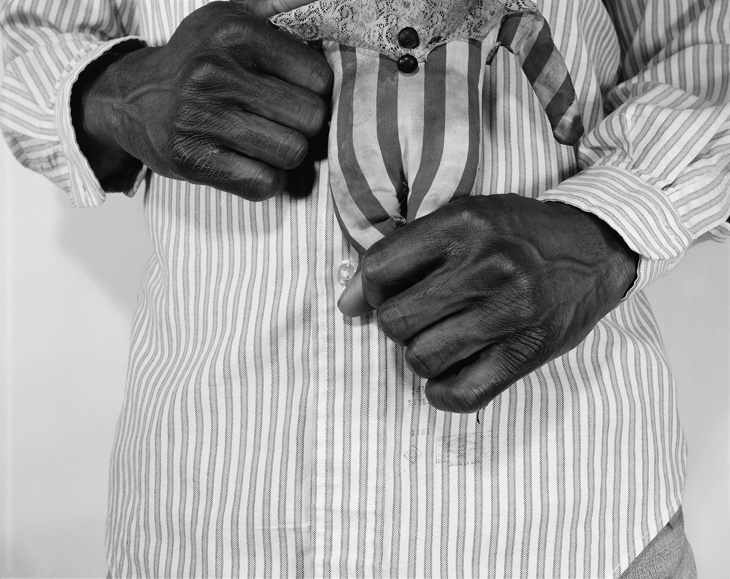 Black Hands with Doll.jpg