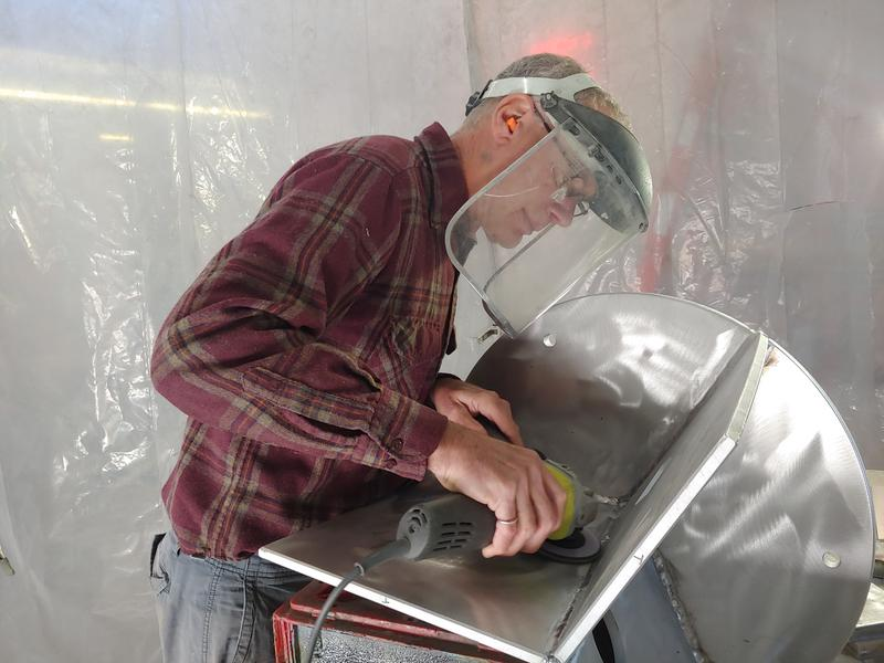 Richard Taylor operates a metal grinder in his studio.   CREDIT CHUCK QUIRMBACH