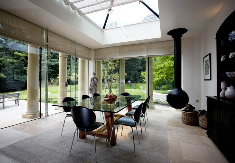 Genuine French Pinoleum in a contemporary garden room with hanging fireplace