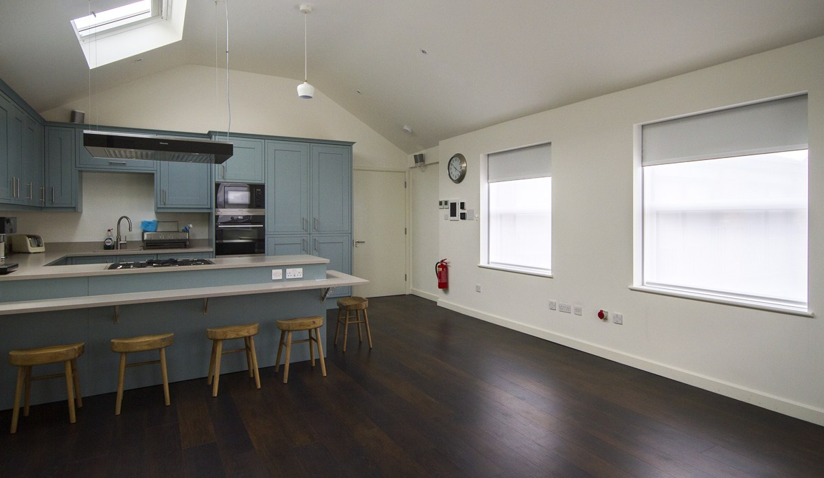 Blue kitchen with concealed double blinds.jpg