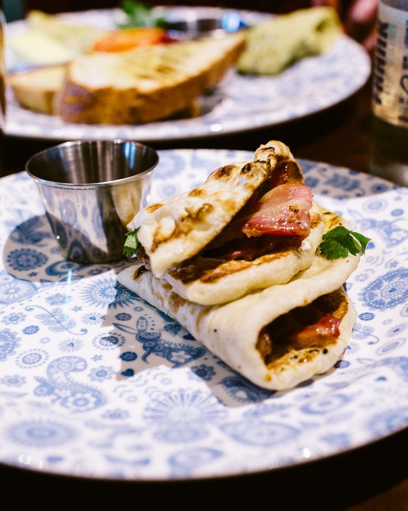 Dishoom 's breakfast naan stuffed with bacon