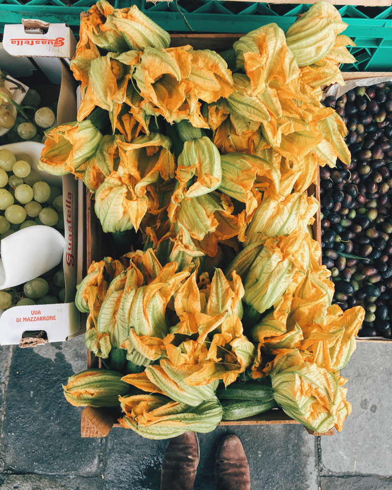 Courgette flowers for sale at the market, ideal for stuffing