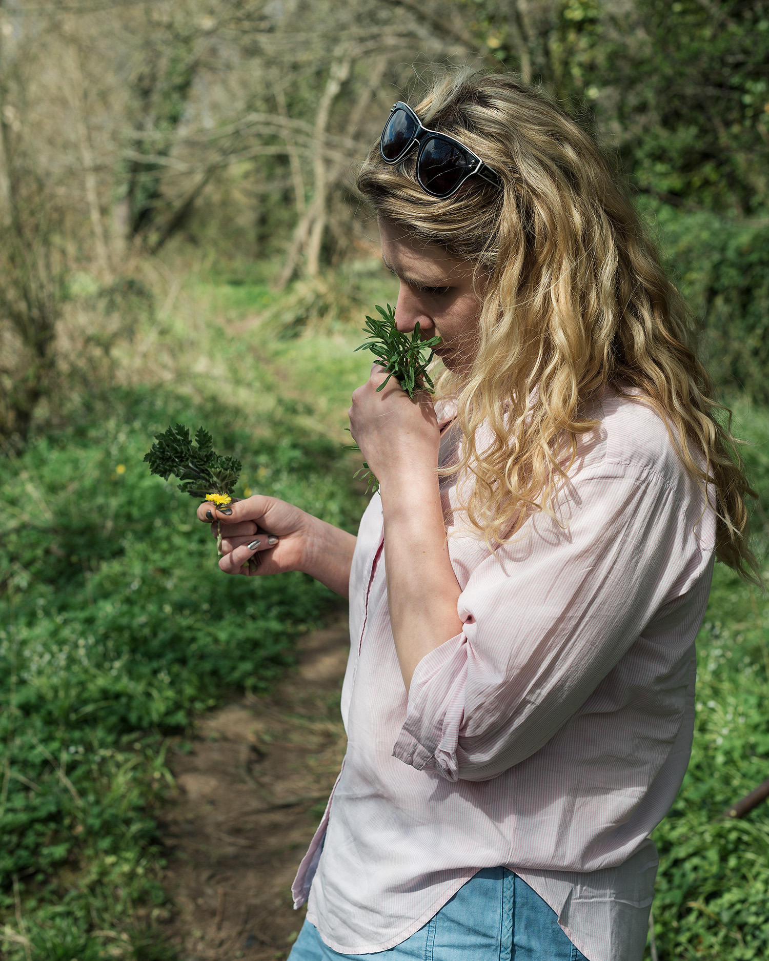 Pip smelling foraged herbs