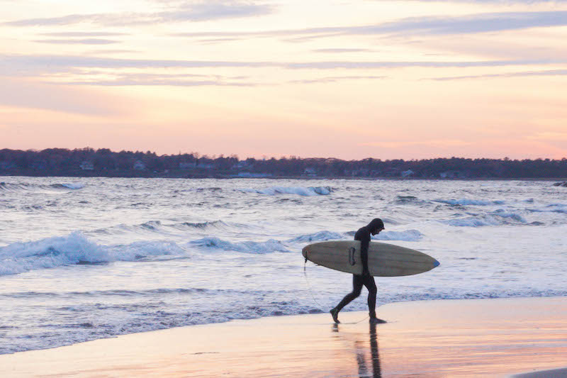 Late autumn sunsets and surfers willing to brave the very cold waves