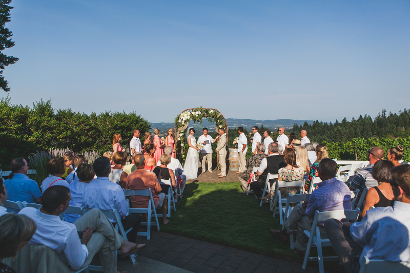 The wedding party danced down the aisle and instead of a bouquet, the bridesmaids held filled glasses of wine!