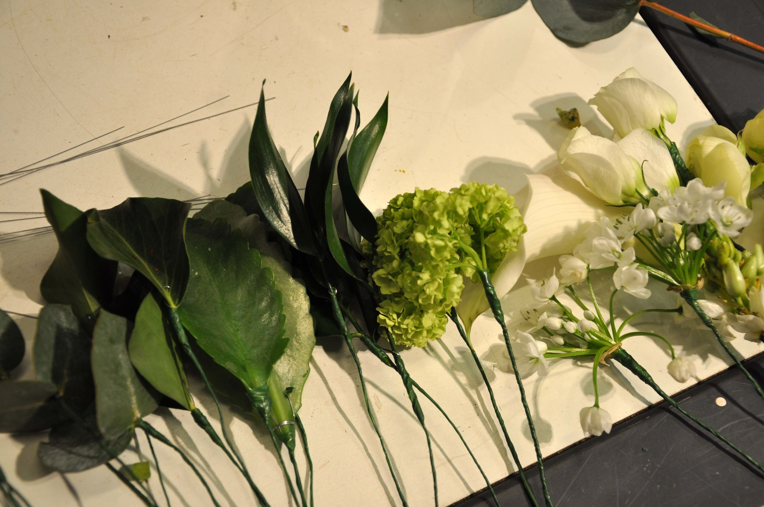 Selection of wired flower lying on worktop