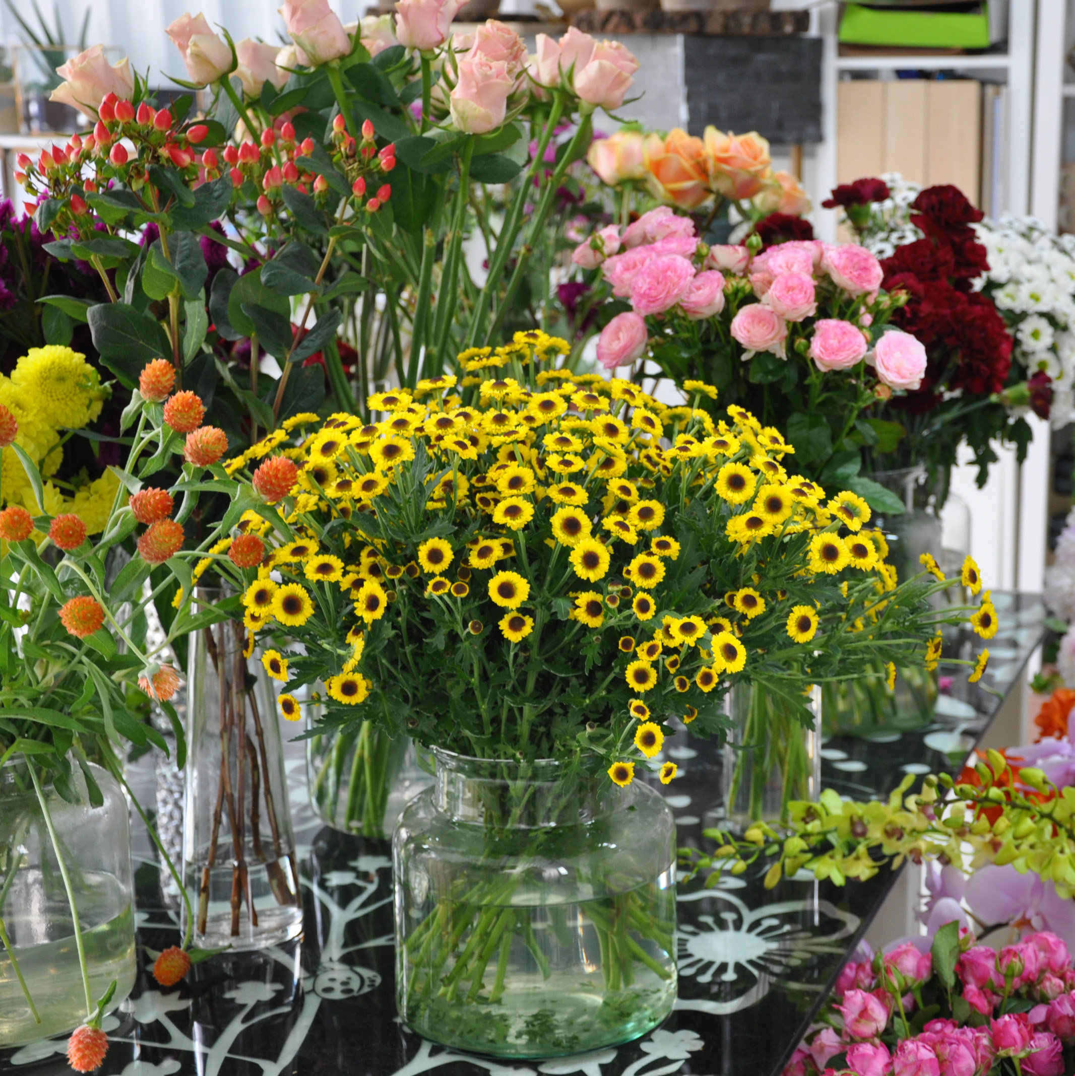 florist display table of fresh flowers