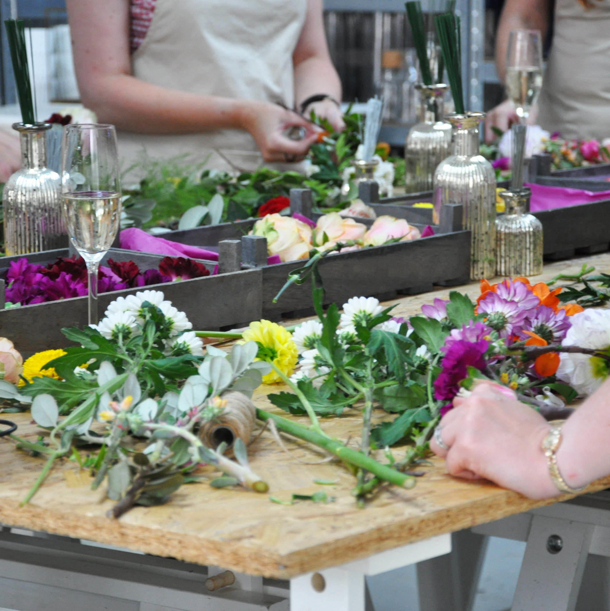 florists workbench covered in flowers