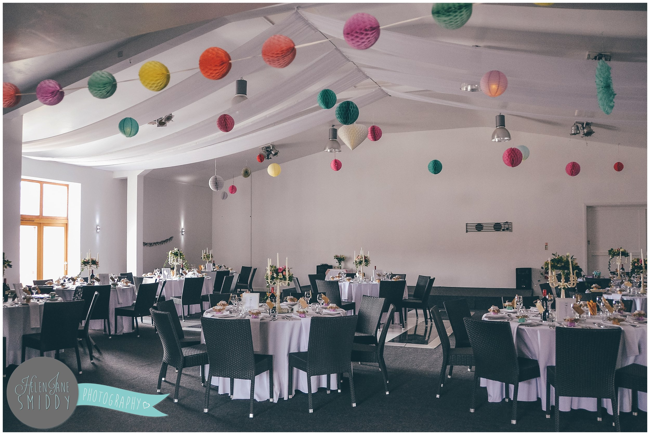 Colourful lanterns make up a beautiful and creative interior of a wedding venue.