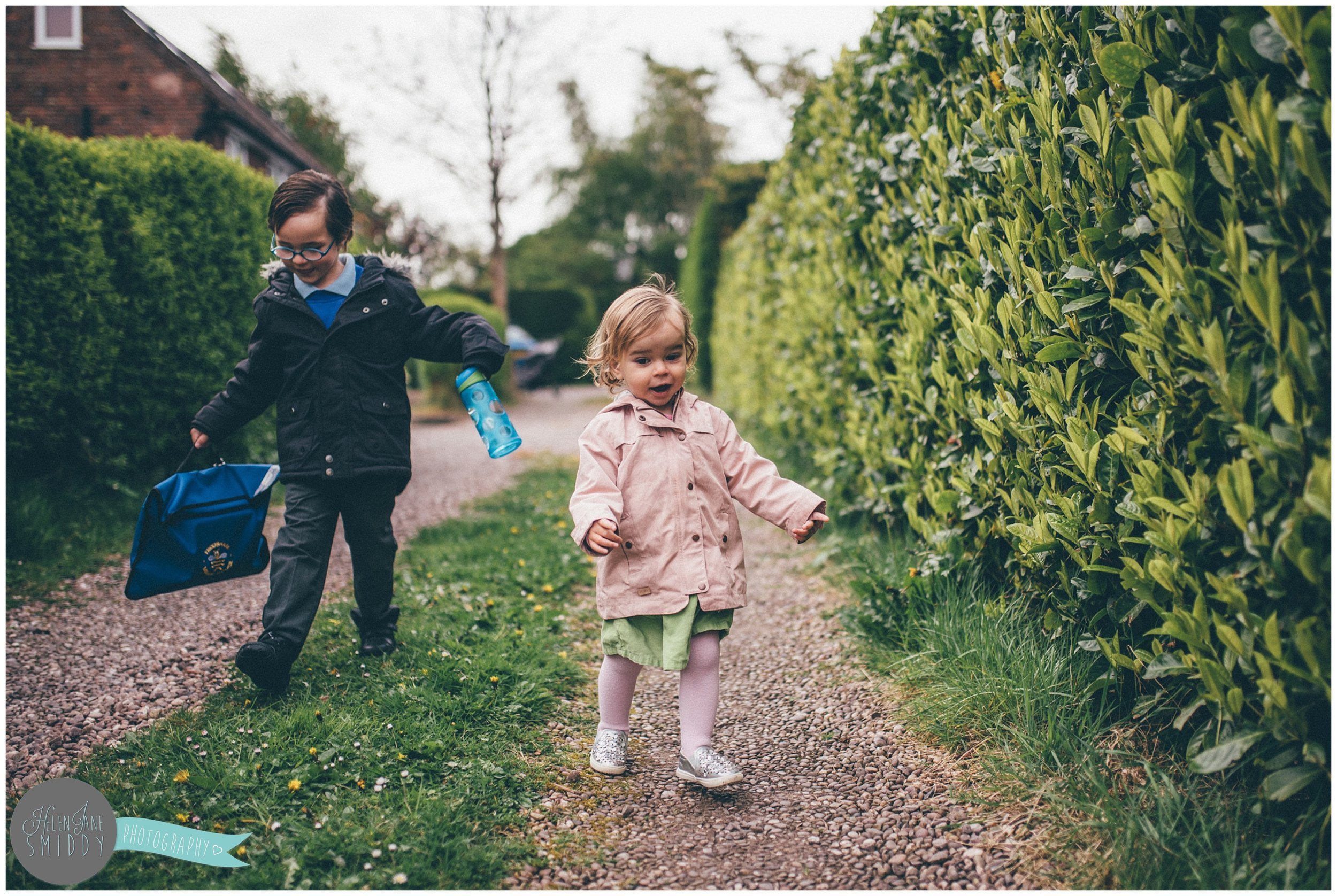 Brother and sister walking to school during A Day In The Life photoshoot in Frodsham, Cheshire.