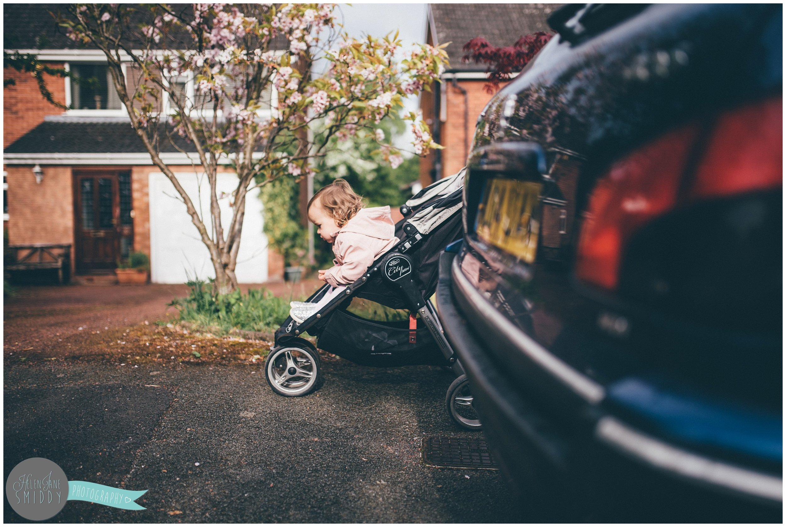 Little Zoe in her buggy during A Day In The Life photoshoot in Frodsham, Cheshire.