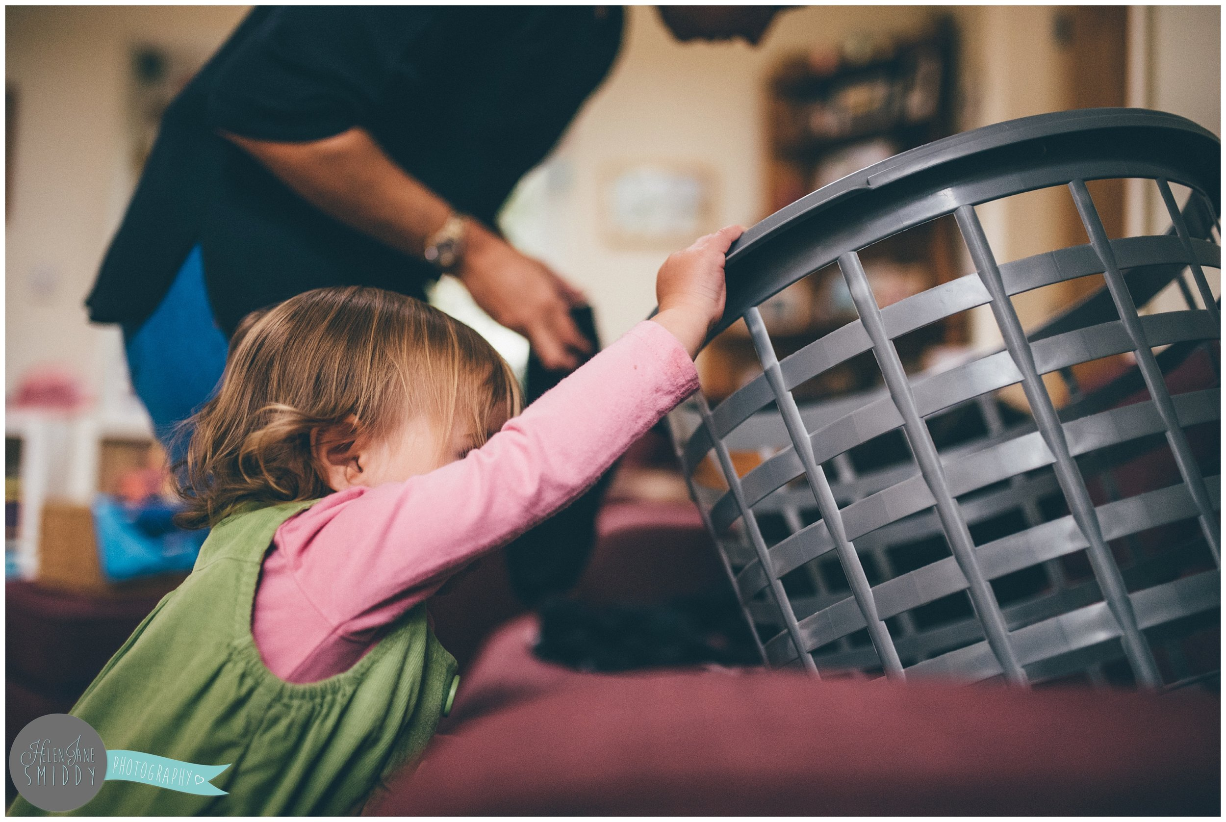 Helping Mummy with laundry during A Day In The Life photoshoot in Frodsham, Cheshire.