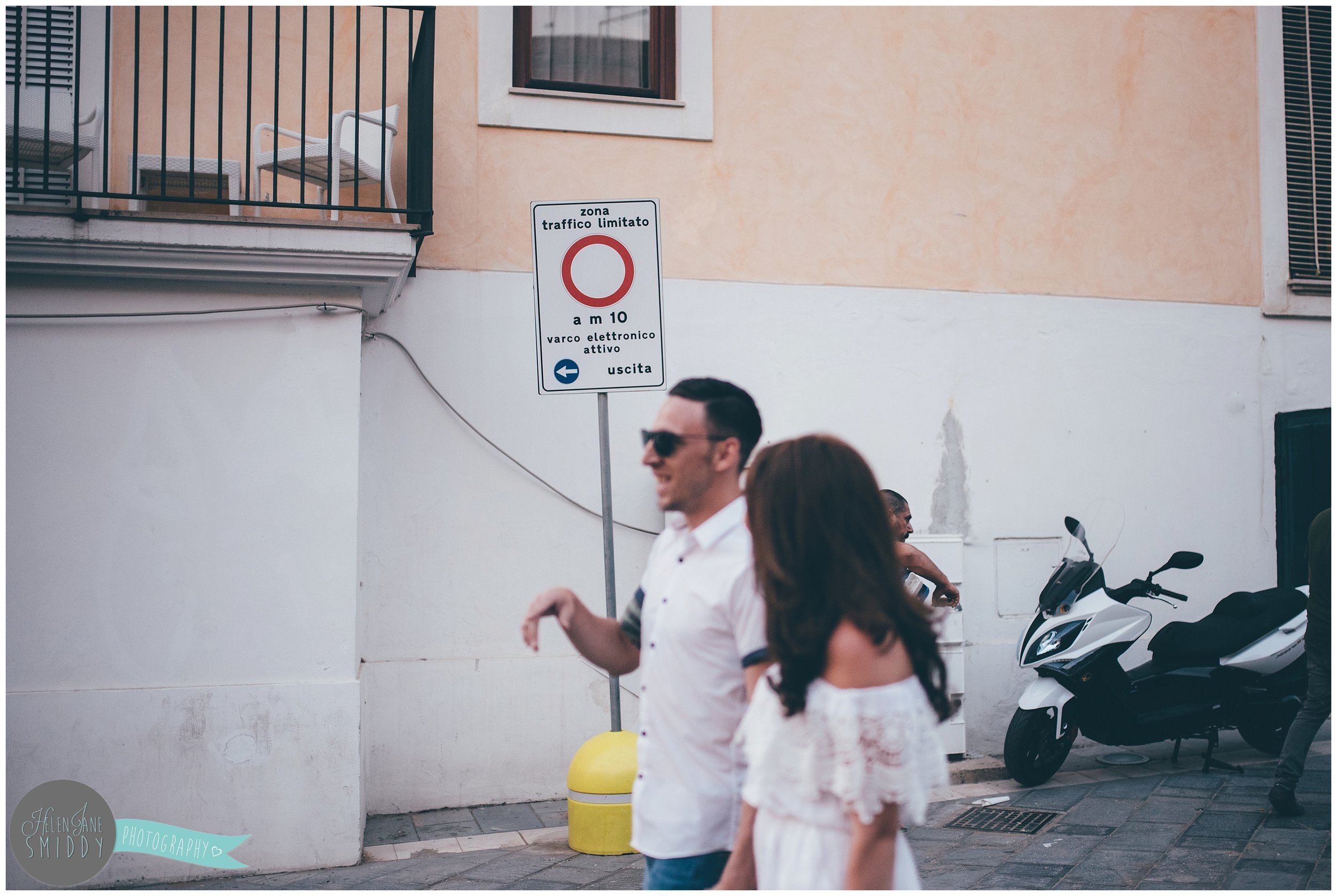 The couple chat during their engagement shoot in Italy.